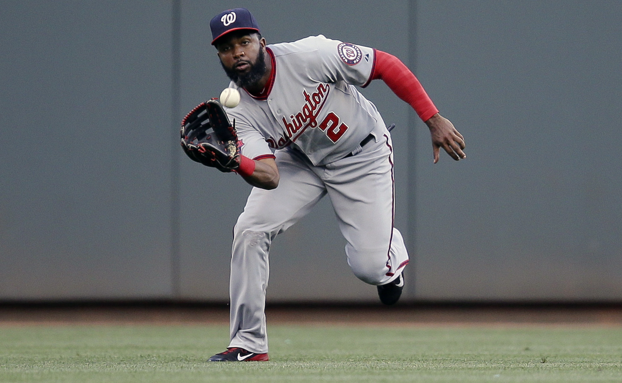Washington Nationals center fielder Denard Span catches out Cincinnati Reds' Marlon Byrd in the second inning of a baseball game, Friday, May 29, 2015, in Cincinnati. (AP Photo/John Minchillo)