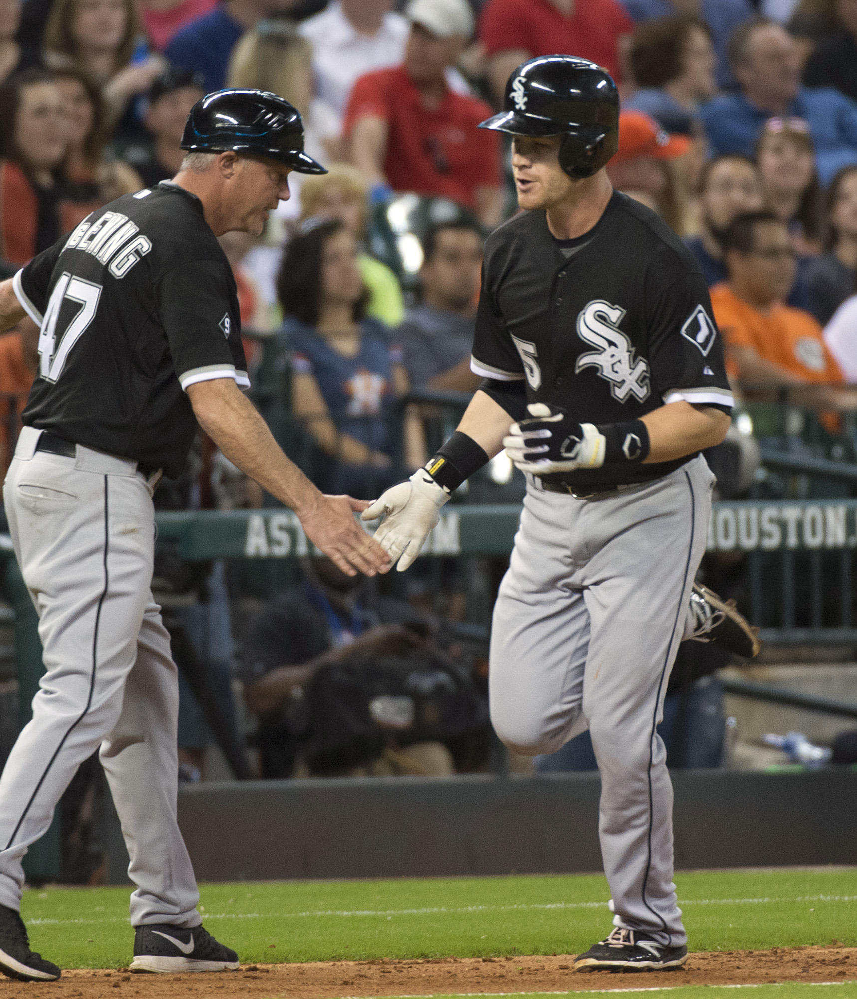 Chicago White Sox's Gordon Beckham (15) is congratulated by third base coach Joe McEwing after hitting a solo home run against the Houston Astros during the eighth inning of a baseball game Friday, May 29, 2015, in Houston. (AP Photo/George Bridges)