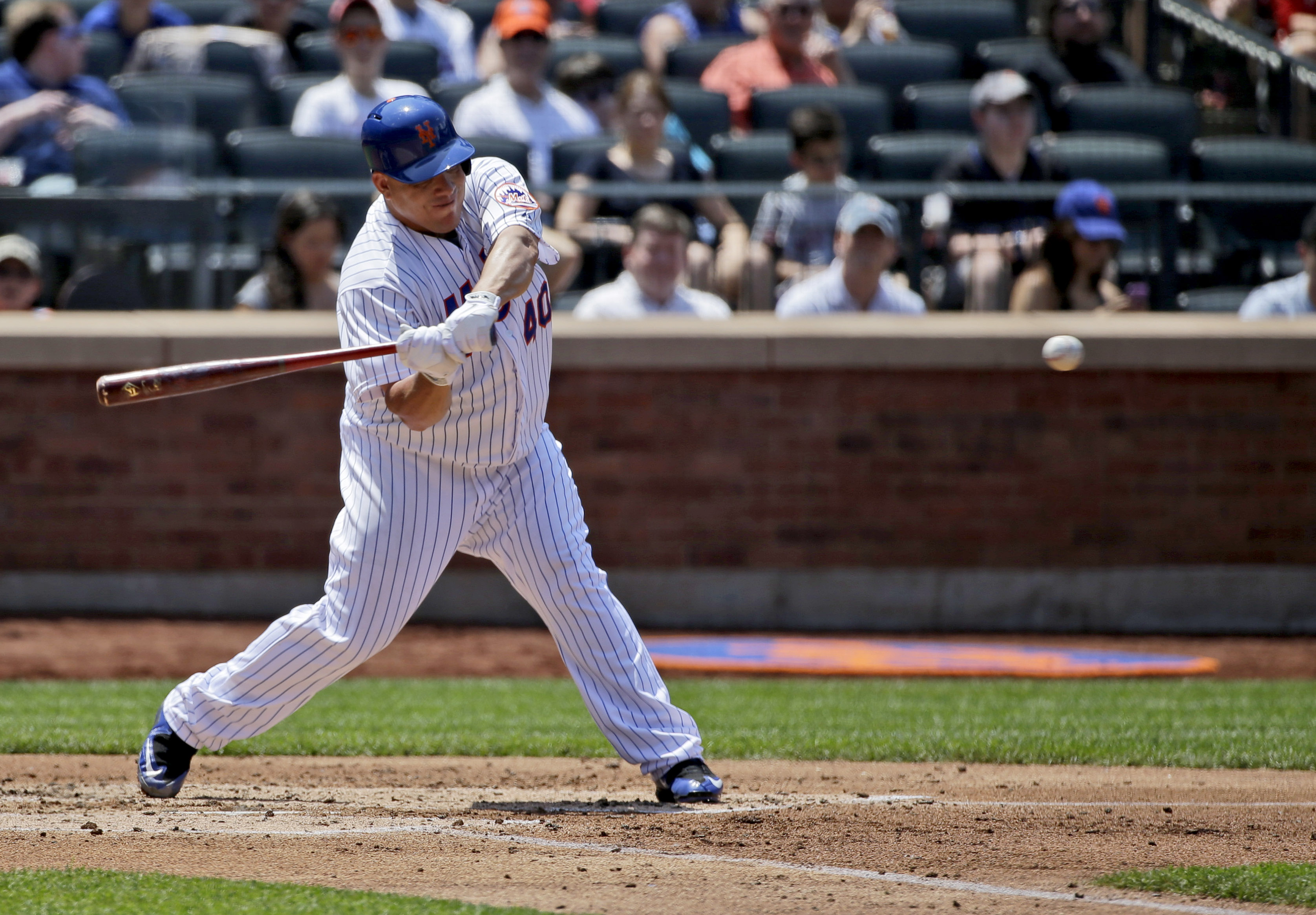 New York Mets' Bartolo Colon hits an RBI-double during the second inning of the baseball game against the Miami Marlins, Sunday, May 31, 2015, in New York. (AP Photo/Seth Wenig)