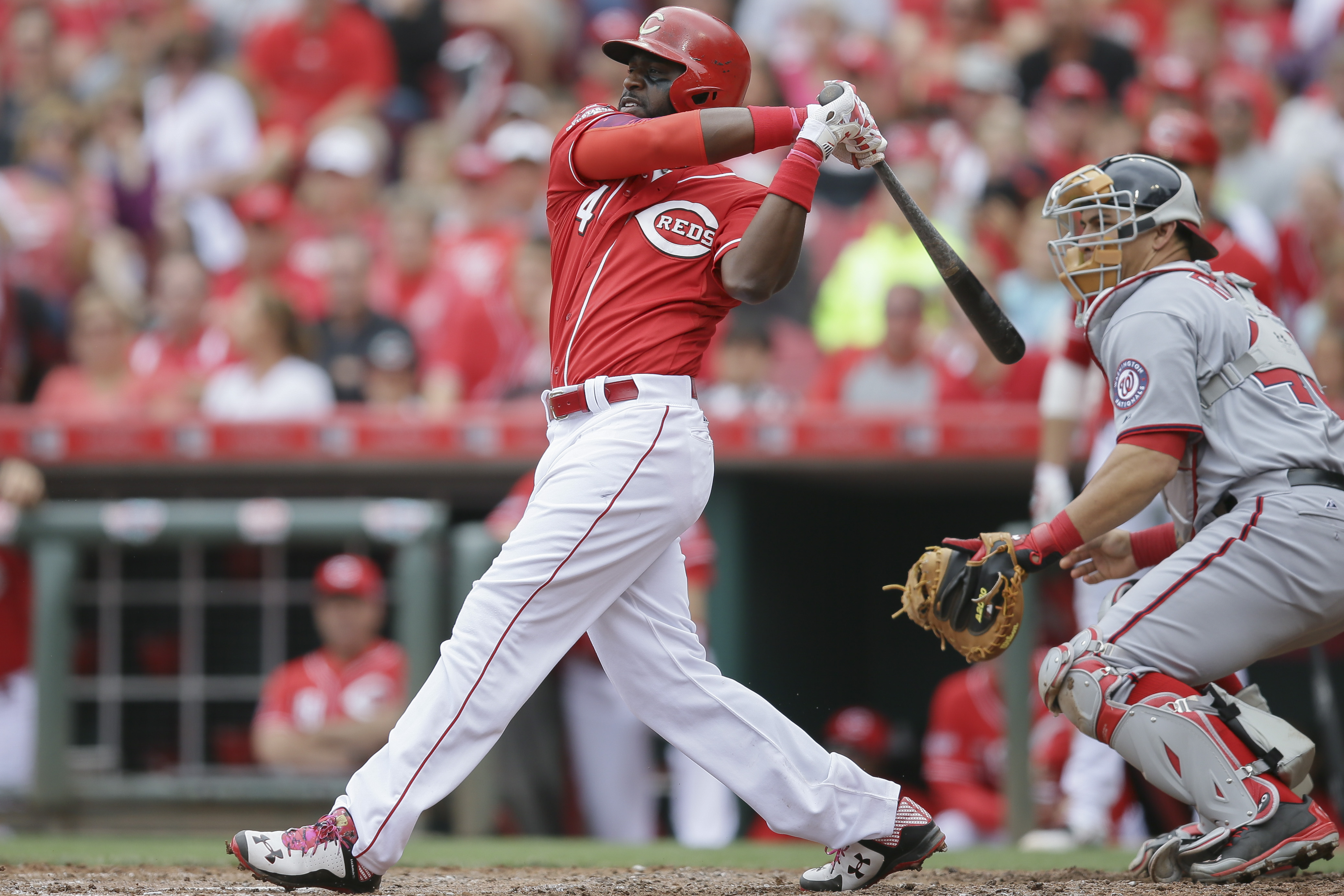 Cincinnati Reds' Brandon Phillips hits a double to drive home Billy Hamilton to start a six-run rally in the seventh inning of a baseball game against the Washington Nationals, Sunday, May 31, 2015, in Cincinnati. (AP Photo/John Minchillo)