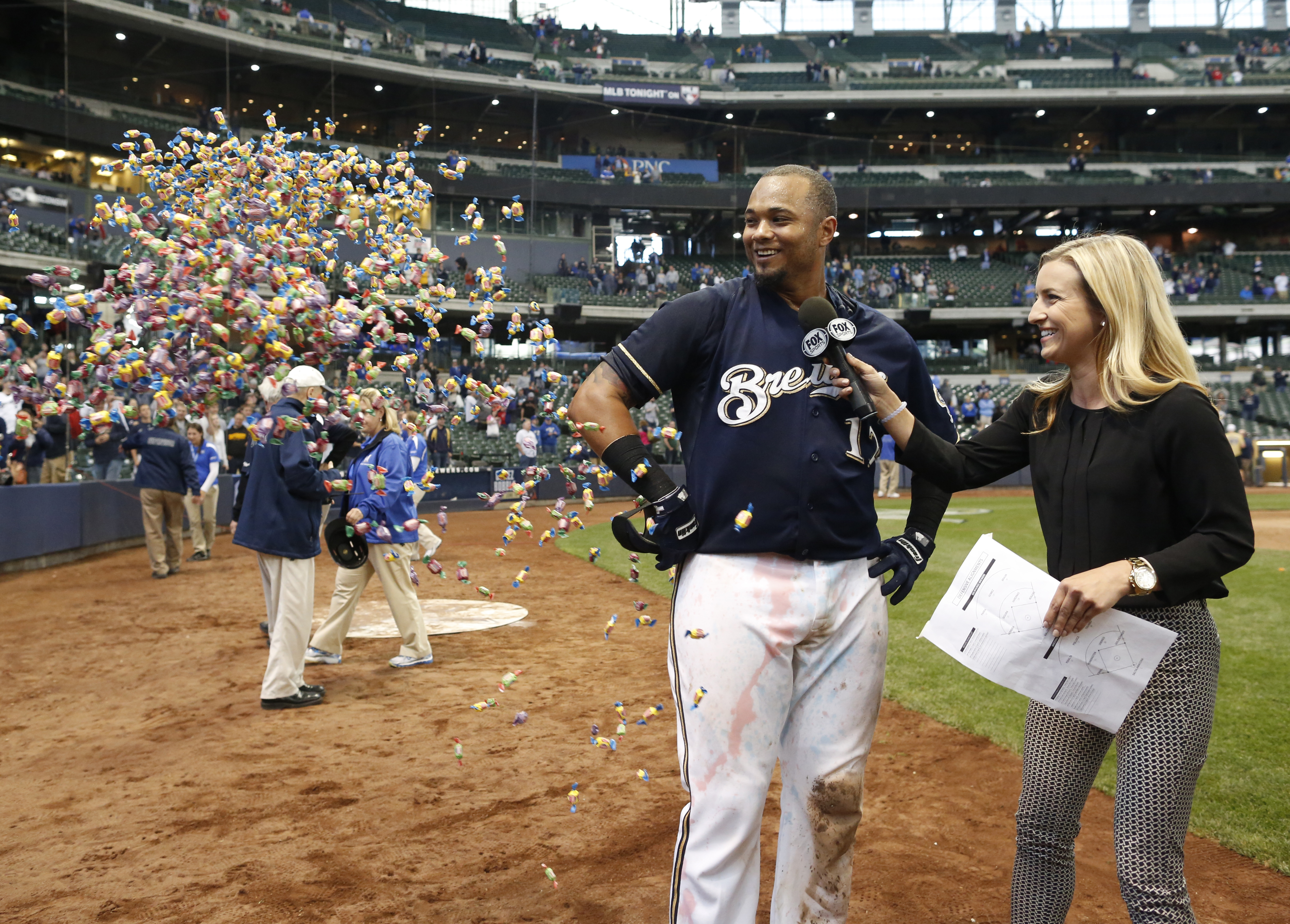 Milwaukee Brewers' Martin Maldonado is showered with bubble gum during a post game interview after their 7-6 victory against the Arizona Diamondbacks in a 17 inning baseball game, Sunday, May 31, 2015, in Milwaukee. Maldonado hit the game winning home run