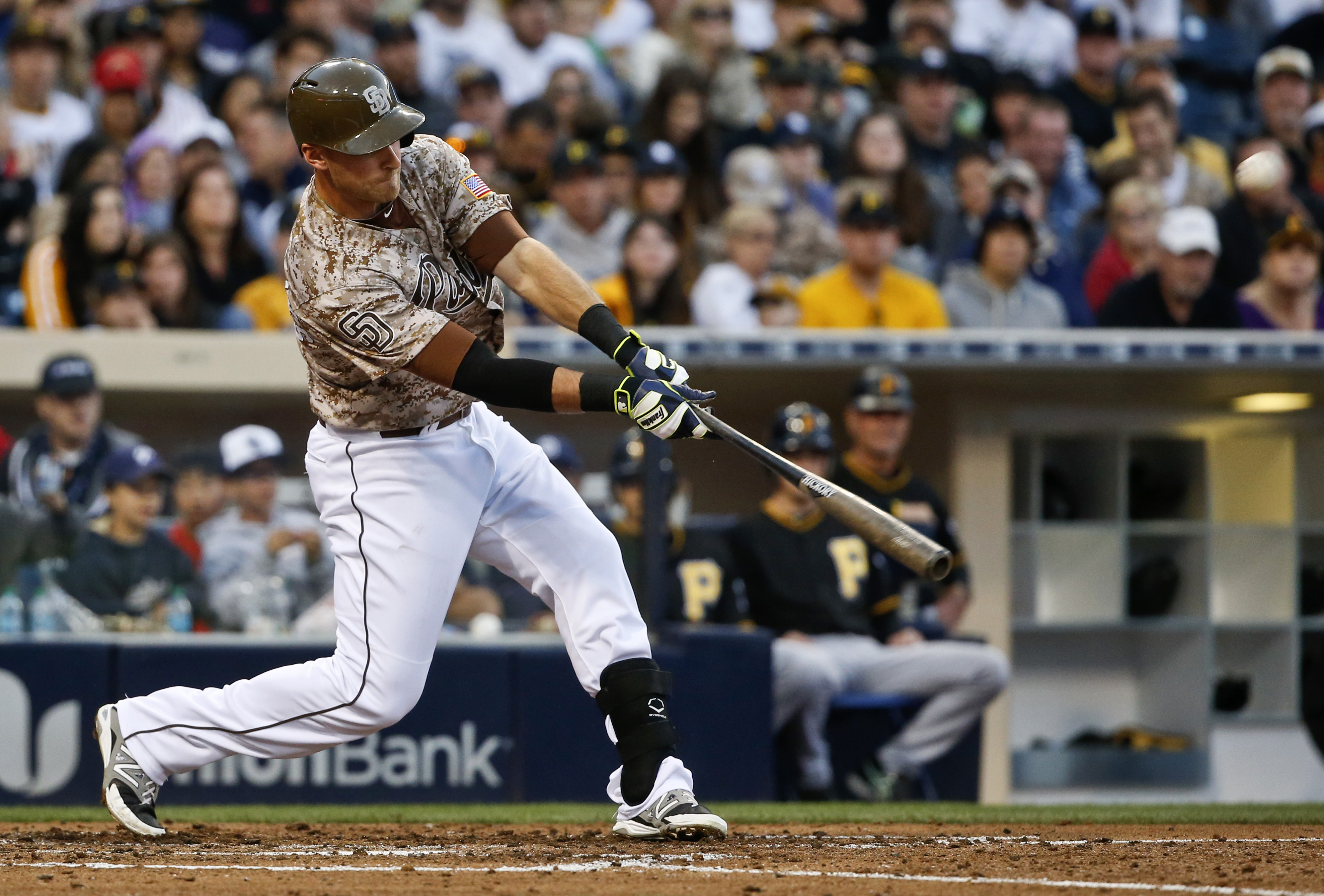 San Diego Padres' Will Middlebrooks drive in his third run of the game with a deep sacrifice fly to center field in the fourth inning of a baseball game against the Pittsburgh Pirates Sunday, May 31, 2015, in San Diego.  (AP Photo/Lenny Ignelzi)