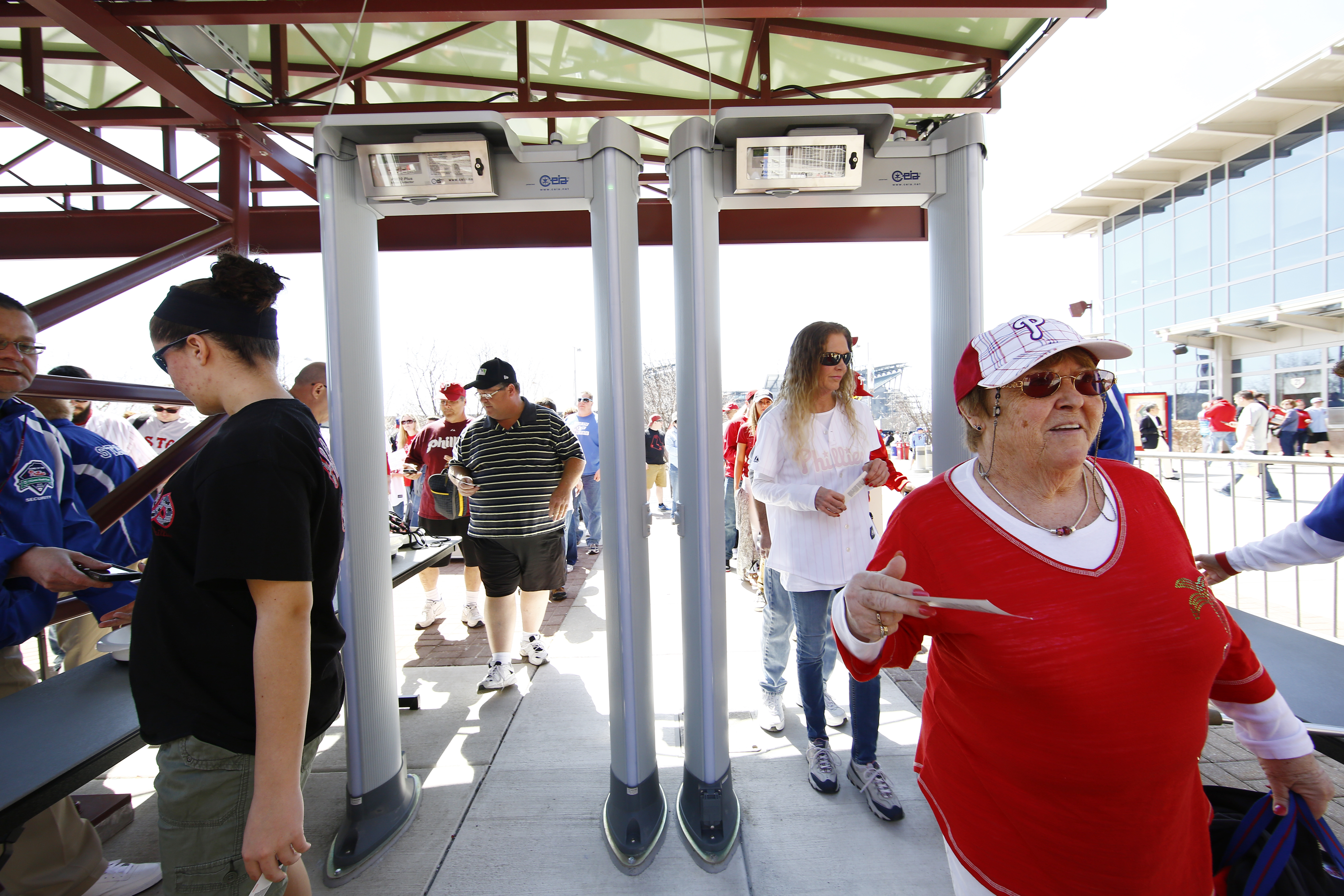Fans pass through metal detectors ahead of the Philadelphia Phillies opening day baseball game against Boston Red Sox on Monday, April 6, 2015, in Philadelphia. Citizens Bank Park has installed walk-through metal detectors to comply with Major League Base