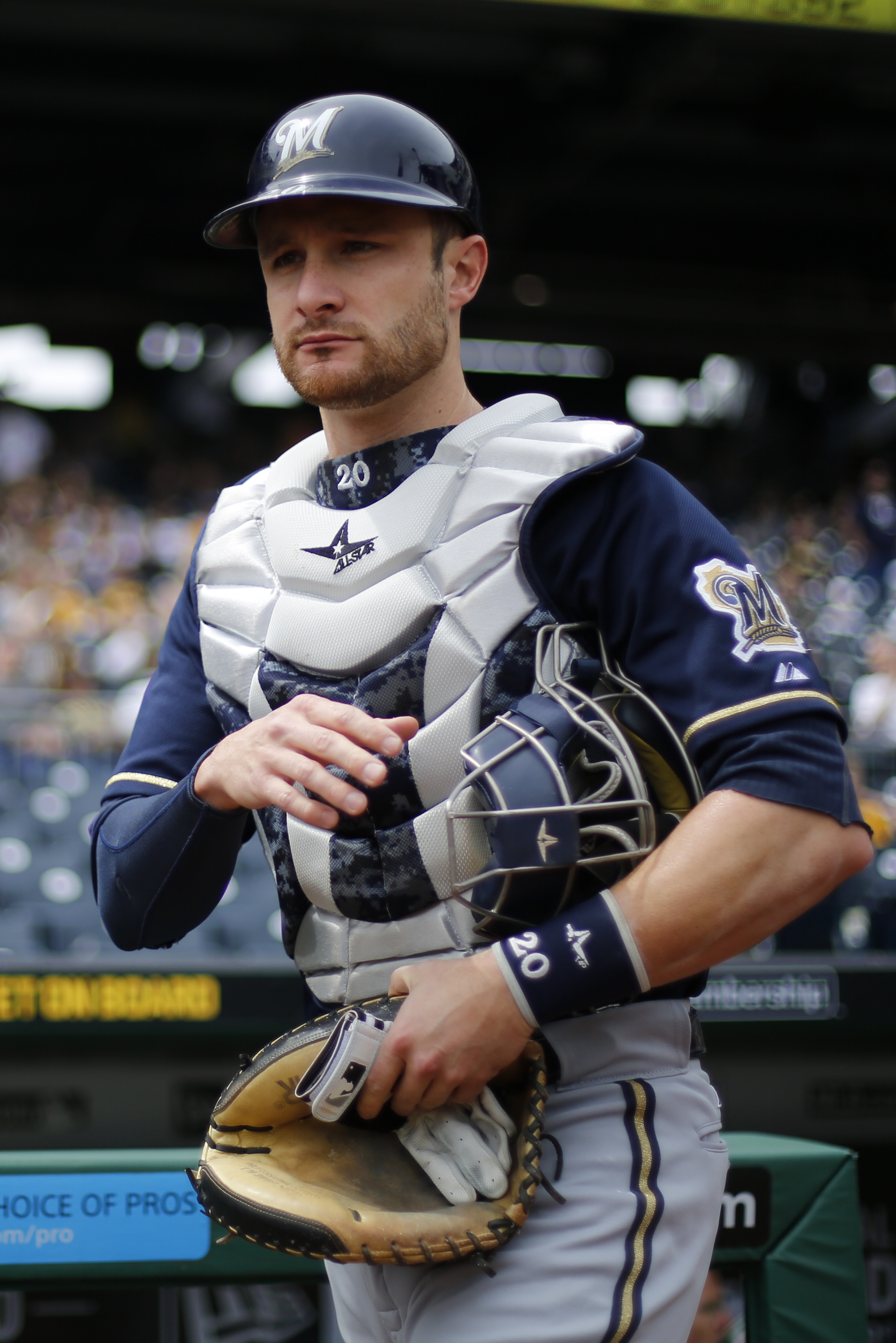 Milwaukee Brewers catcher Jonathan Lucroy heads to the bullpen to warm up pitcher starting pitcher Matt Garza before a baseball game against the Pittsburgh Pirates in Pittsburgh, Sunday, April 19, 2015. (AP Photo/Gene J. Puskar)