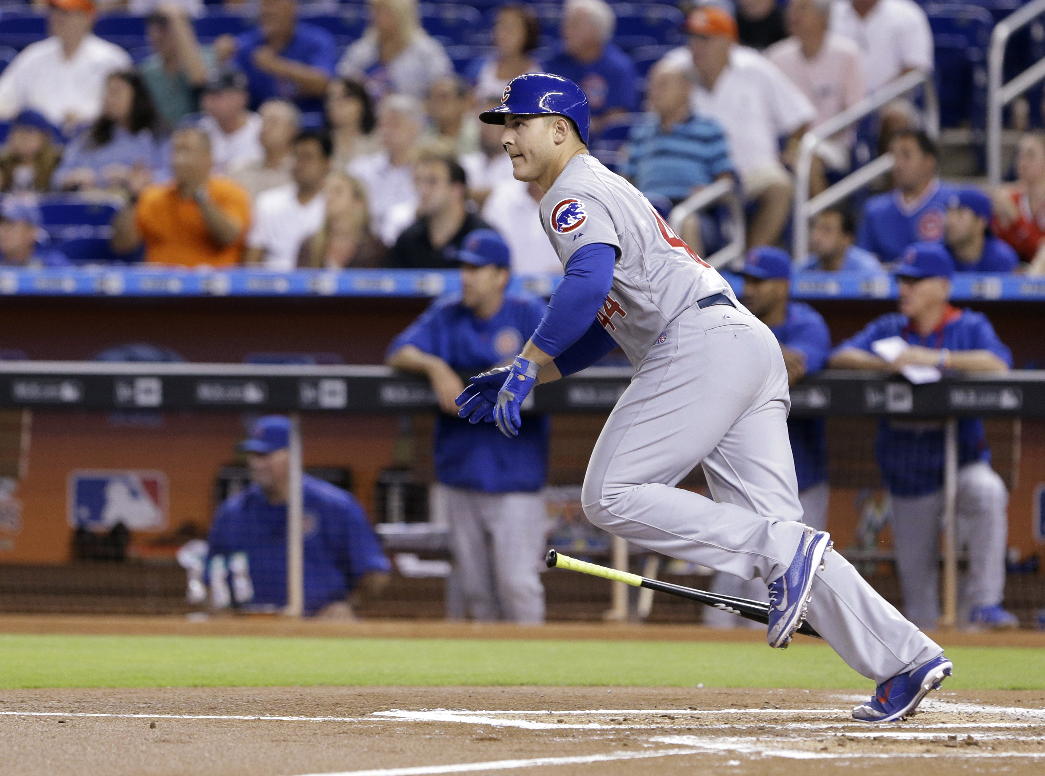 Chicago Cubs' Anthony Rizzo watches his hit as he runs to first during the first inning of a baseball game against the Miami Marlins, Monday, June 1, 2015, in Miami. Rizzo doubled scoring Dexter Fowler. (AP Photo/Wilfredo Lee)