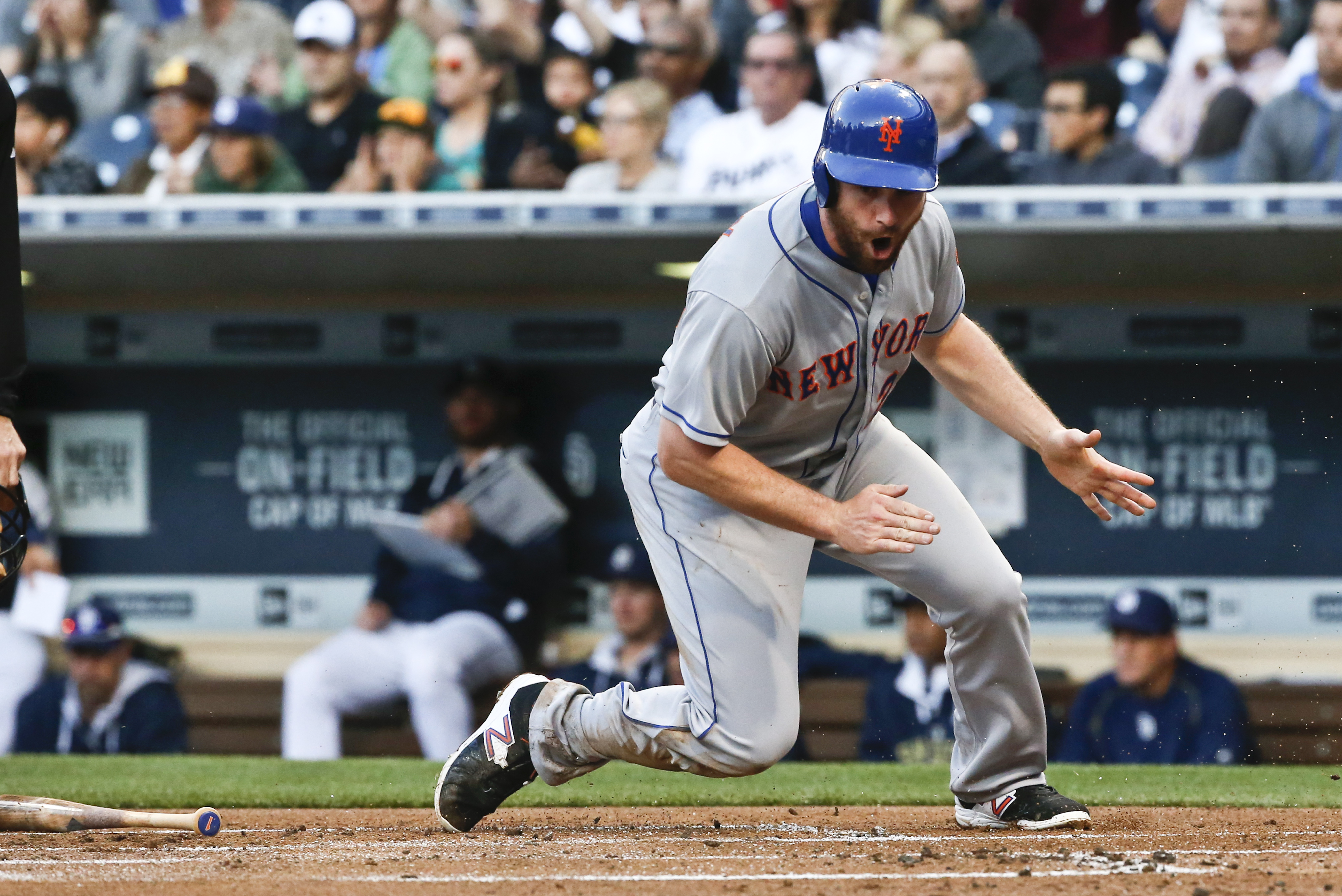New York Mets' Daniel Murphy slaps his hands after scoring from second after a throwing error by San Diego Padres third baseman Will Middlebrooks in the first inning of a baseball game Monday, June 1, 2015, in San Diego.  (AP Photo/Lenny Ignelzi)