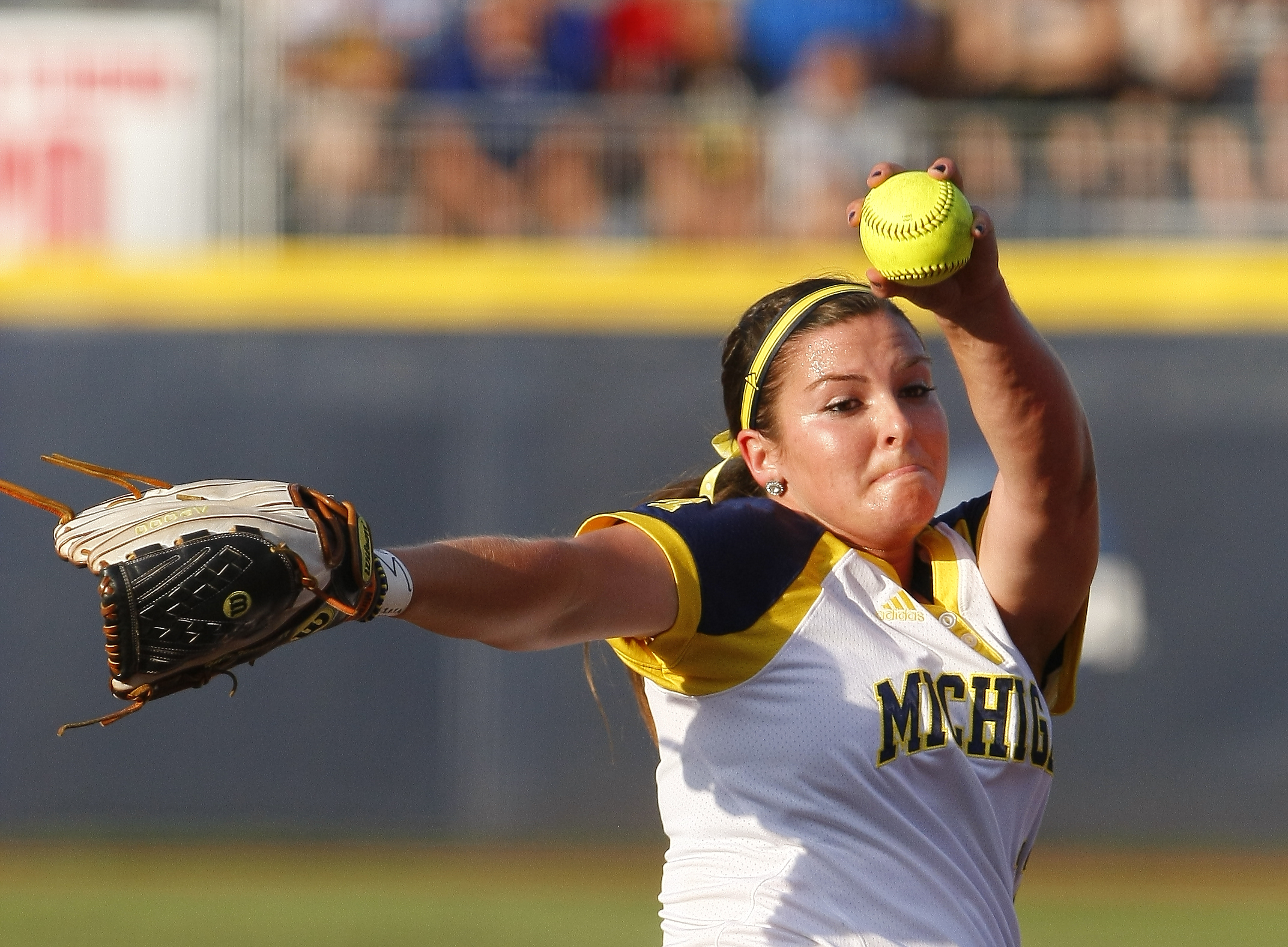 Michigan starter Haylie Wagner pitches against Florida during the first inning of Game 2 of the finals in the NCAA softball Women's College World Series, Tuesday, June 2, 2015, in Oklahoma City. (AP Photo/Alonzo Adams)