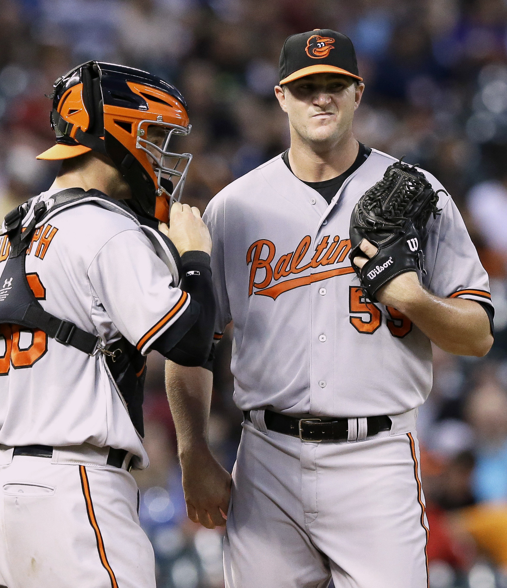 Baltimore Orioles starting pitcher Mike Wright, right, gets a visit to the mound from catcher Caleb Joseph after giving up a double to Houston Astros' Hank Conger in the third inning of a baseball game Tuesday, June 2, 2015, in Houston. (AP Photo/Pat Sull