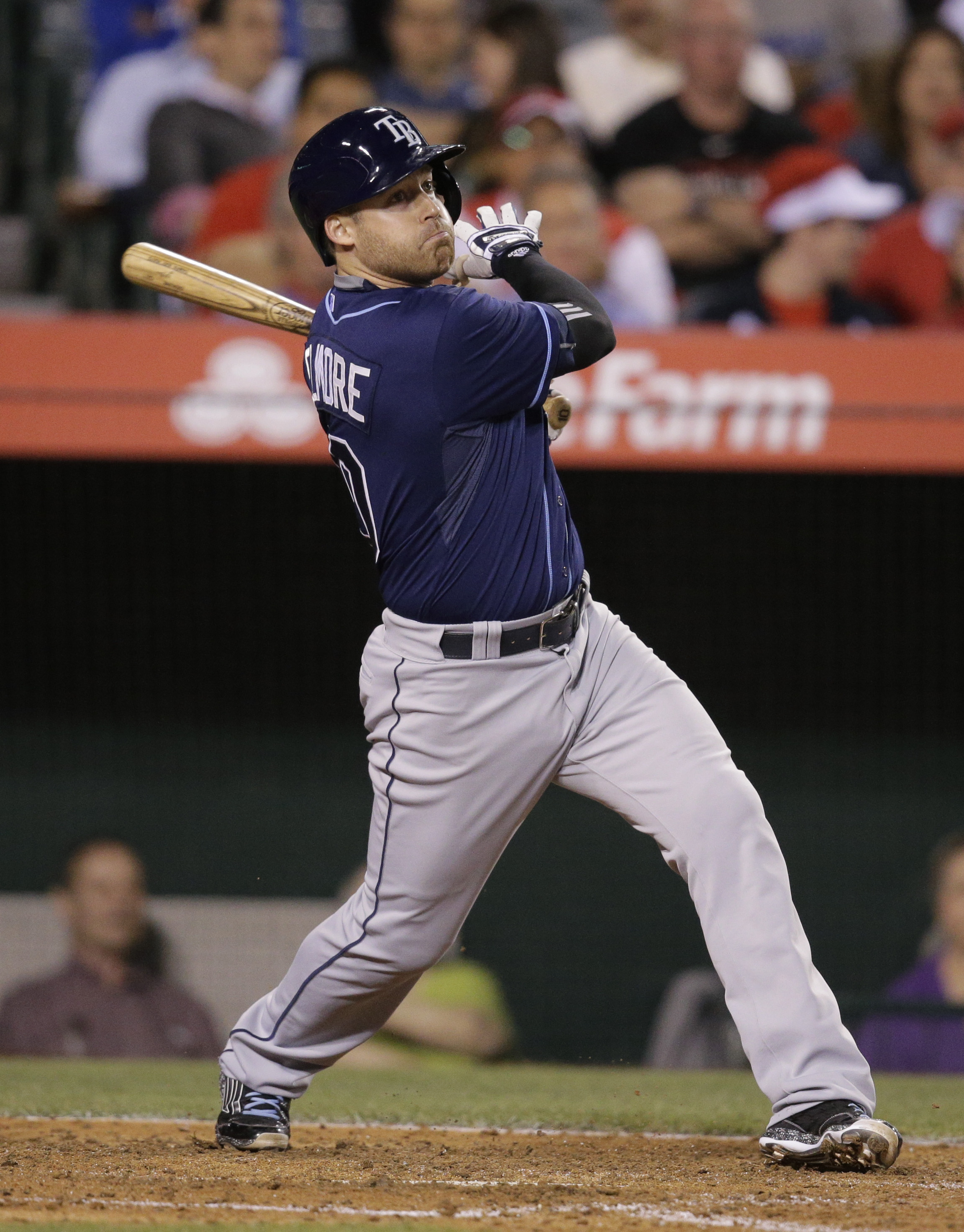 Tampa Bay Rays' Jake Elmore watches his two-run single during the sixth inning of a baseball game against the Los Angeles Angels, Tuesday, June 2, 2015, in Anaheim, Calif. (AP Photo/Jae C. Hong)
