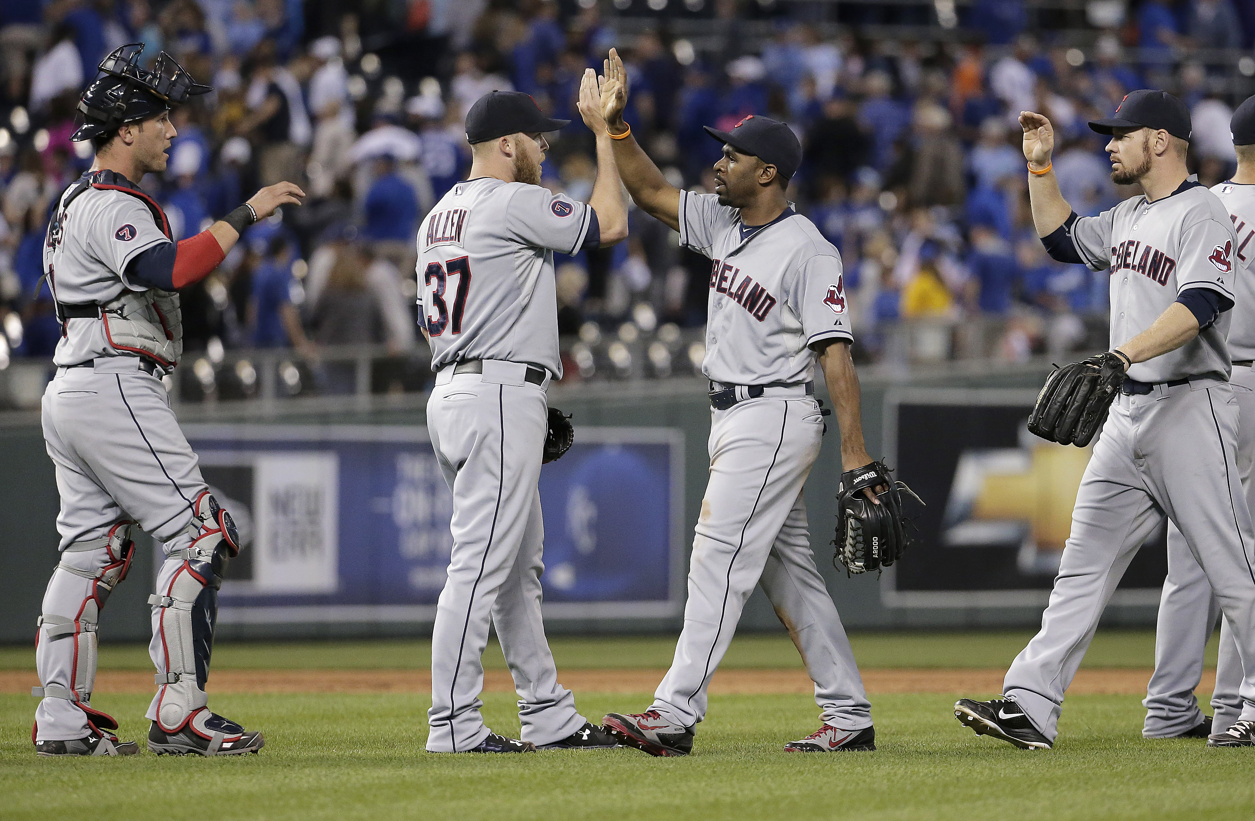 Cleveland Indians celebrate after their baseball game against the Kansas City Royals on Tuesday, June 2, 2015, in Kansas City, Mo. The Indians won 2-1. (AP Photo/Charlie Riedel)