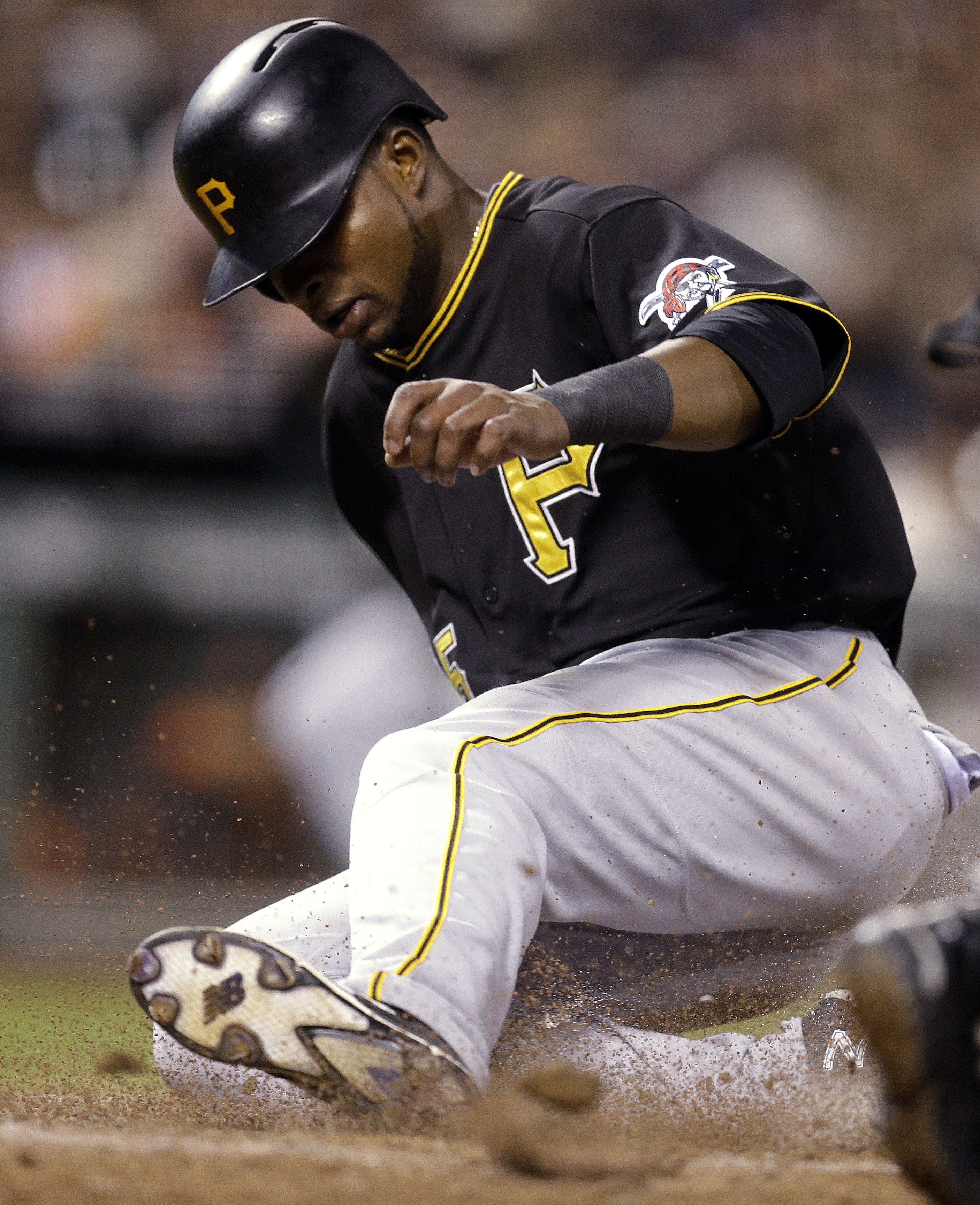 Pittsburgh Pirates' Gregory Polanco slides to score against the San Francisco Giants during the sixth inning of a baseball game Tuesday, June 2, 2015, in San Francisco. Polanco scored on a hit by Andrew McCutchen. (AP Photo/Ben Margot)