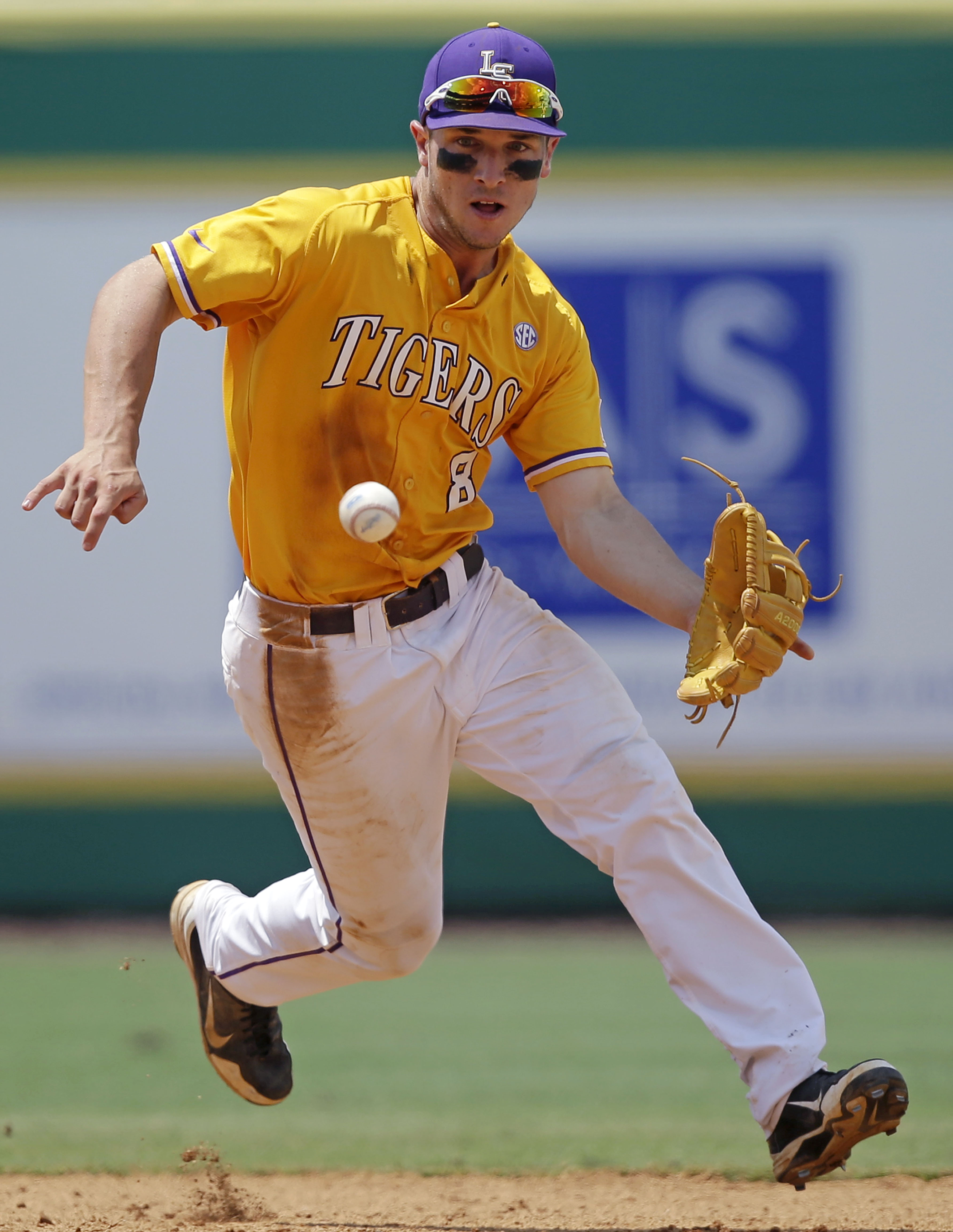 FILE - In this Monday, June 1, 2015, file photo, LSU infielder Alex Bregman (8) fields a grounder hit by UNC Wilmington's Robbie Thorburn in the eighth inning of an NCAA college baseball tournament regional game in Baton Rouge, La. Bergman is among the to