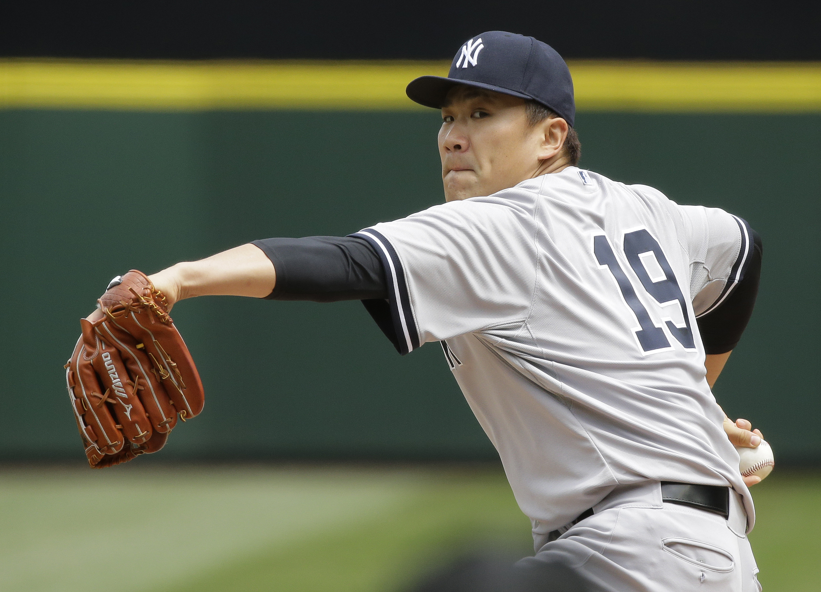 New York Yankees starting pitcher Masahiro Tanaka throws against the Seattle Mariners in the first inning of a baseball game, Wednesday, June 3, 2015, in Seattle. (AP Photo/Ted S. Warren)