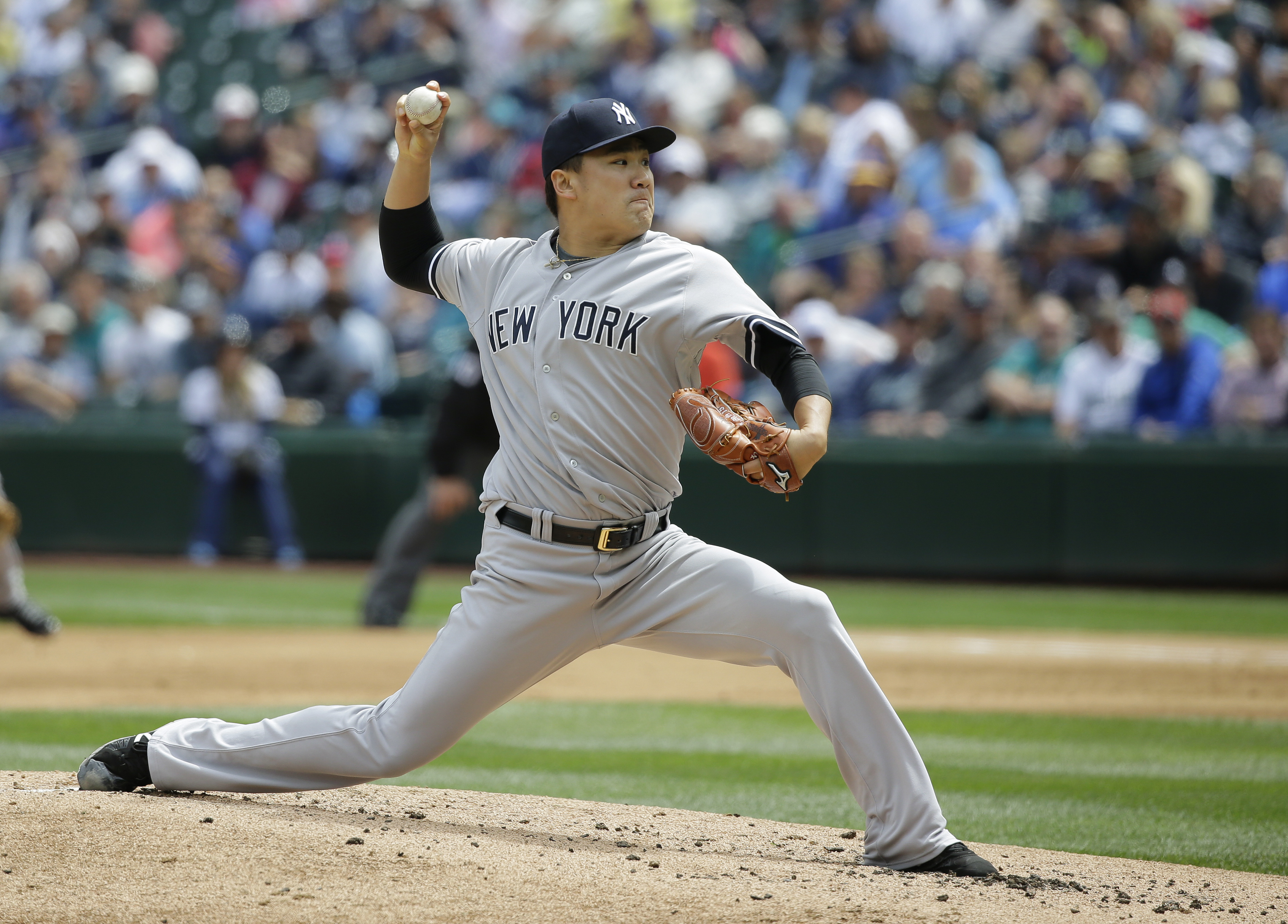 New York Yankees starting pitcher Masahiro Tanaka throws against the Seattle Mariners in the second inning of a baseball game, Wednesday, June 3, 2015, in Seattle. (AP Photo/Ted S. Warren)
