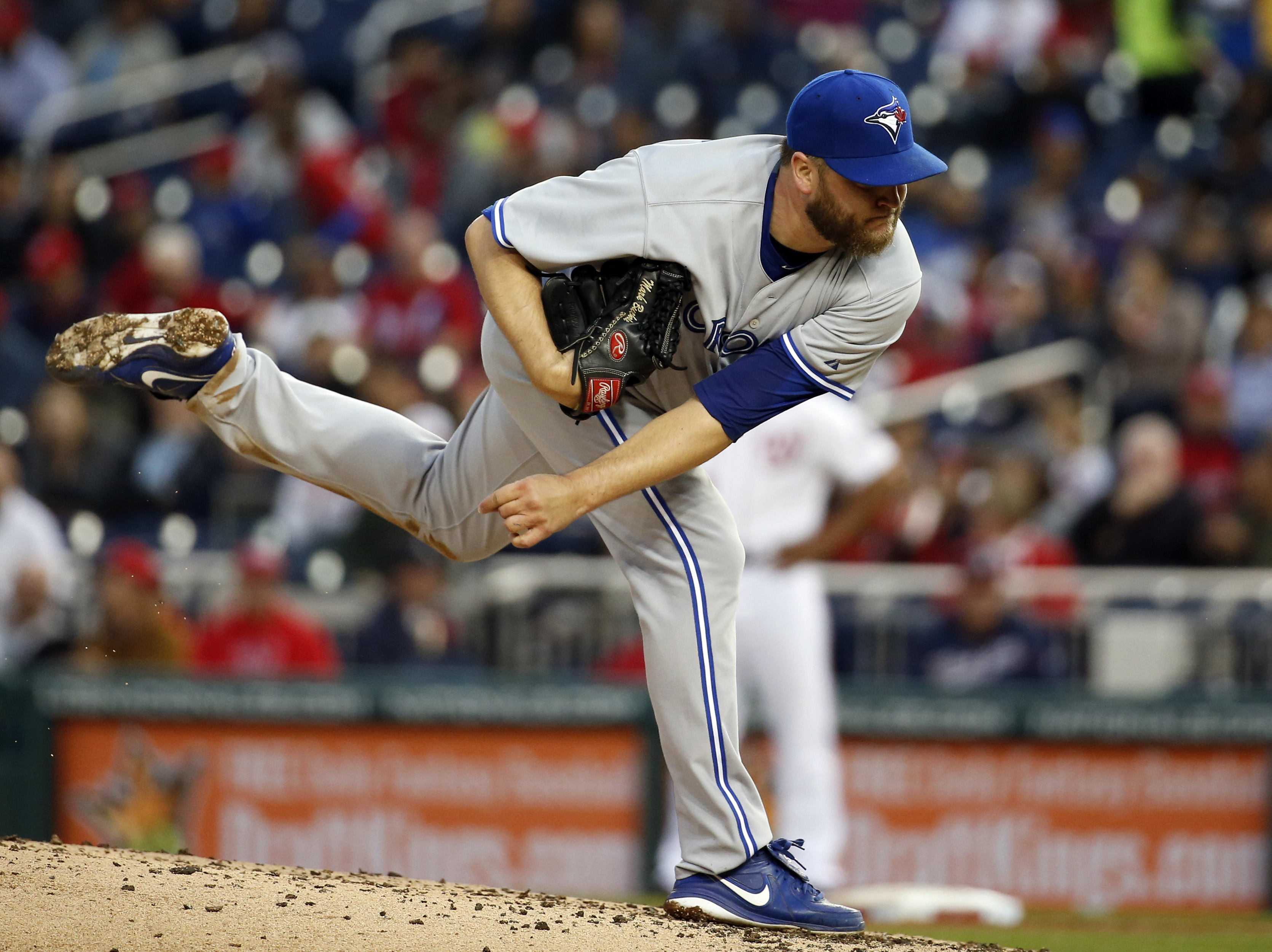 Toronto Blue Jays starting pitcher Mark Buehrle follows through on a pitch during the third inning of a baseball game against the Washington Nationals at Nationals Park, Wednesday, June 3, 2015, in Washington. (AP Photo/Alex Brandon)