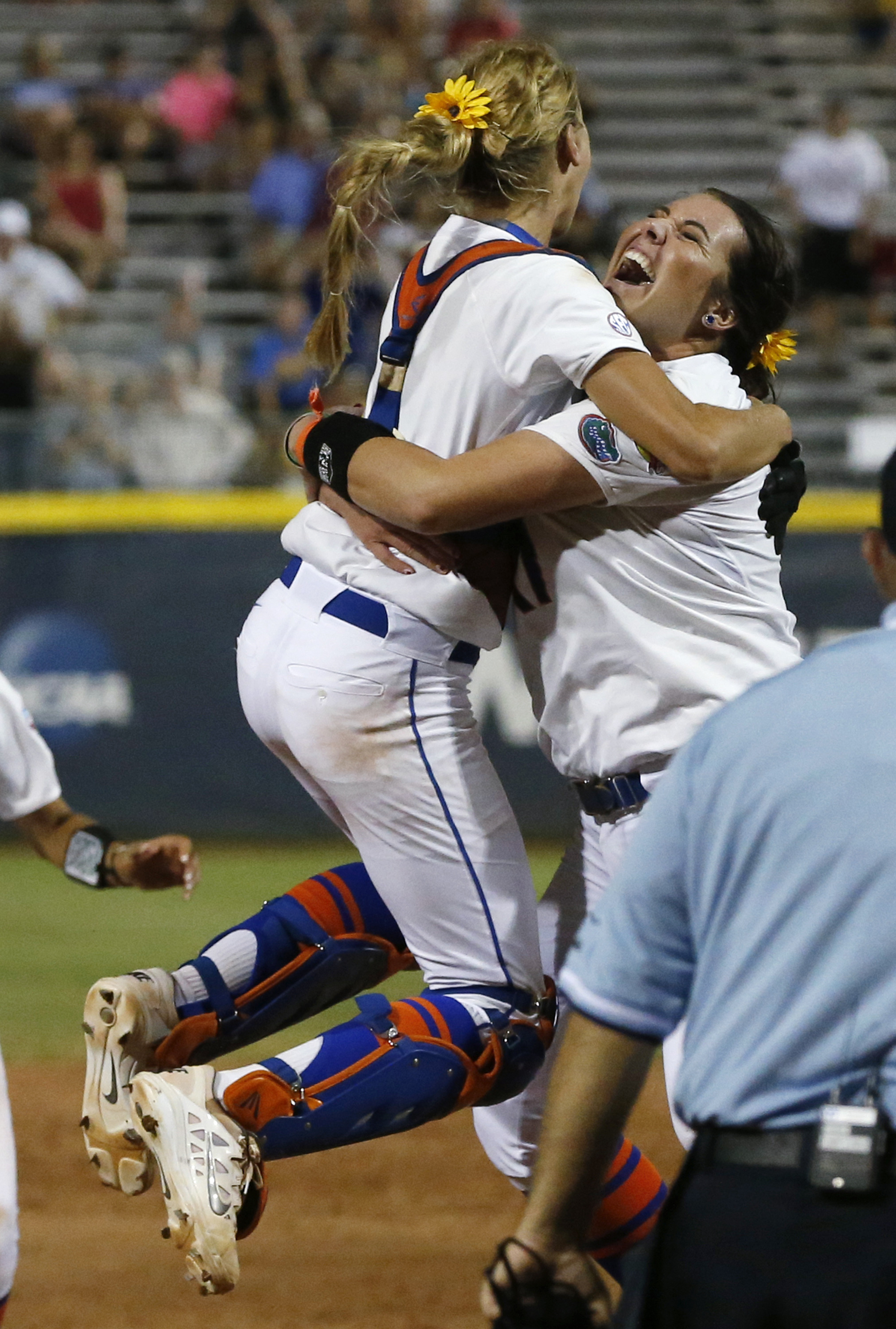 Florida pitcher Lauren Haeger, right, celebrates with catcher Aubree Munro at the end of the final game against Michigan in the NCAA softball Women's College World Series, Wednesday, June 3, 2015, in Oklahoma City. Florida won 4-1. (AP Photo/Sue Ogrocki)