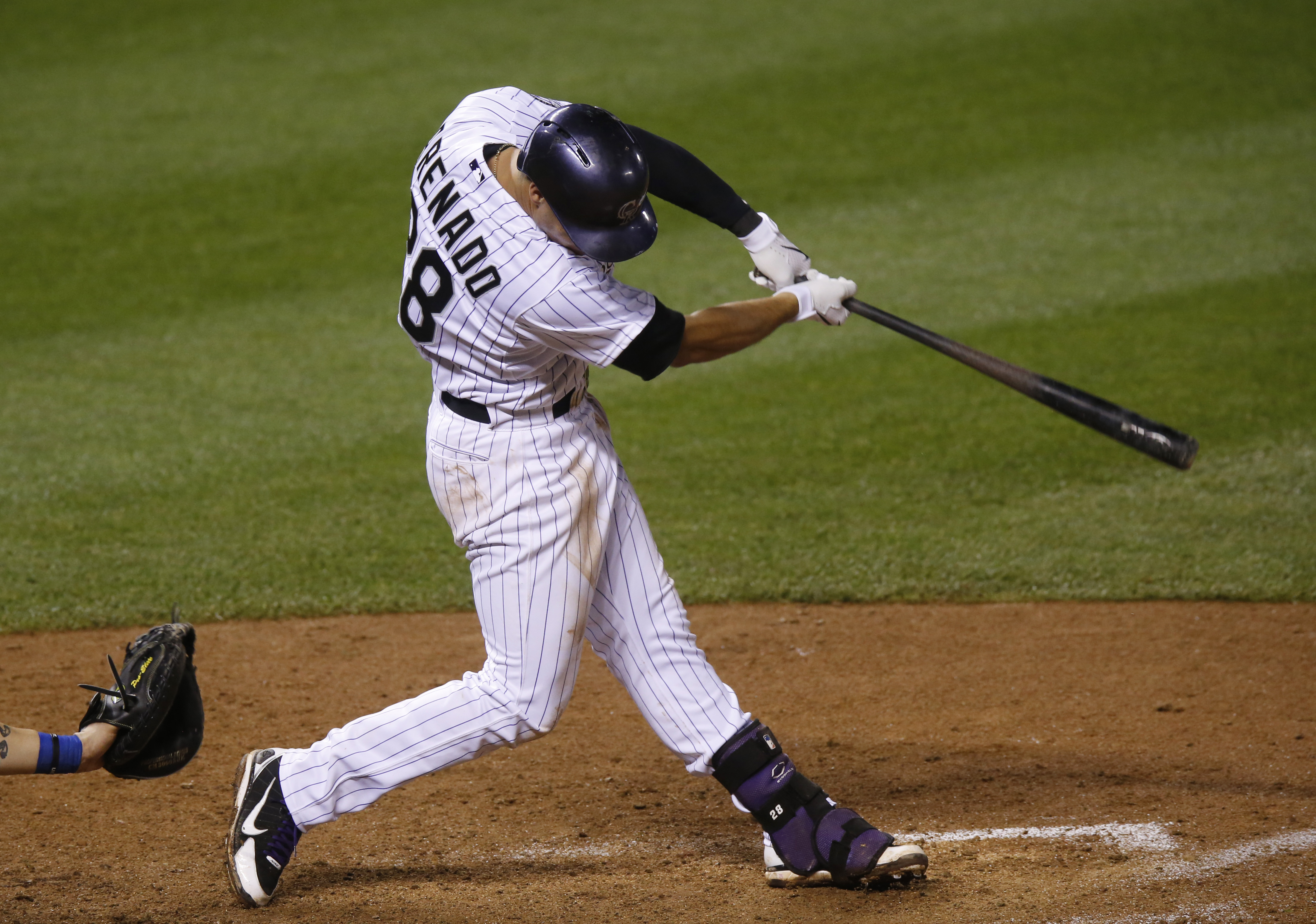 Colorado Rockies' Nolan Arenado hits a walk off sacrifice fly to bring in the winning run off Los Angeles Dodgers relief pitcher Chris Hatcher in the bottom of the ninth inning of a baseball game early Thursday, June 4, 2015, in Denver. Colorado won 7-6.