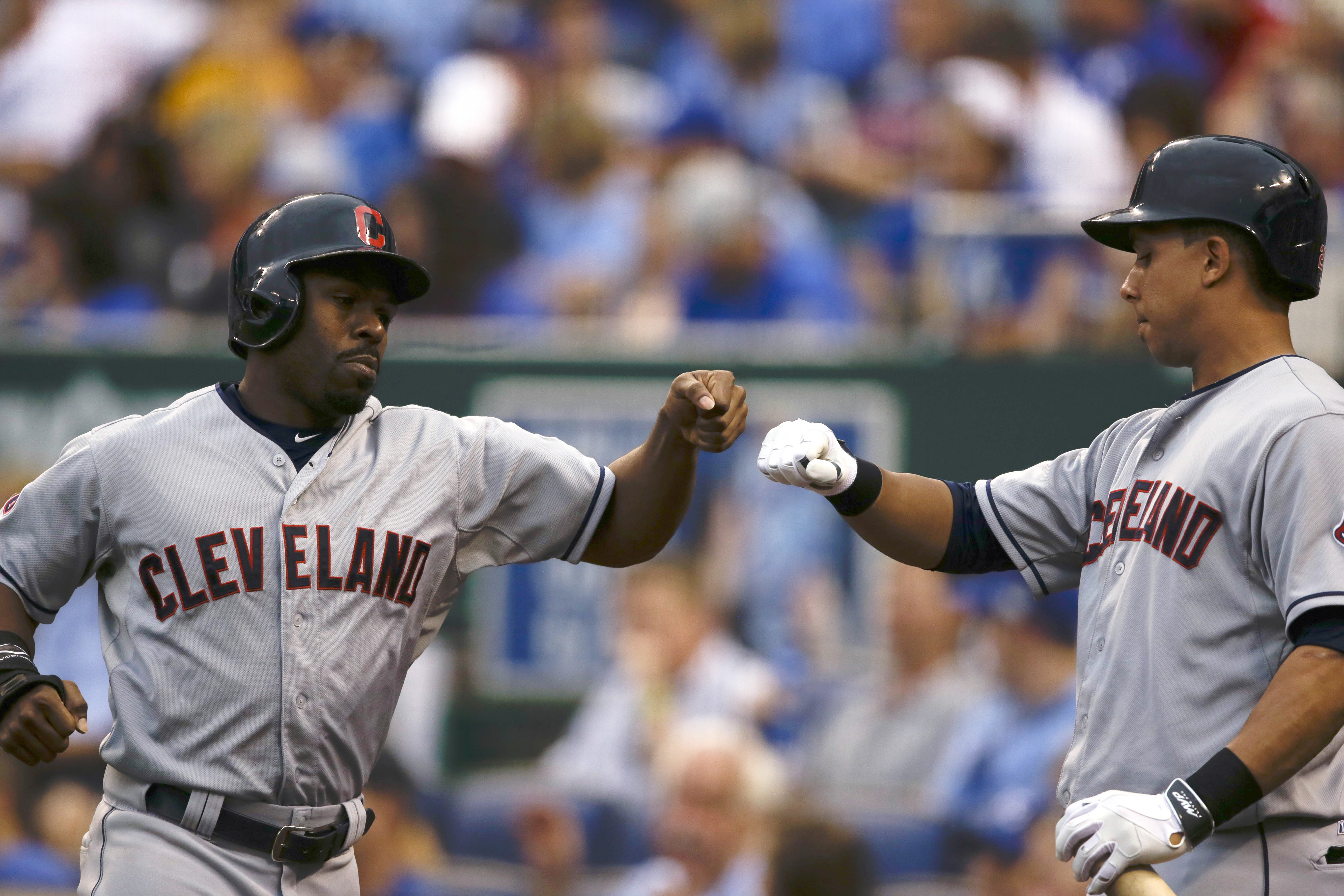Cleveland Indians' Michael Bourn, left, is congratulated by teammate Roberto Perez after scoring on a Jason Kipnis single during the third inning of a baseball game against the Kansas City Royals at Kauffman Stadium in Kansas City, Mo., Thursday, June 4,