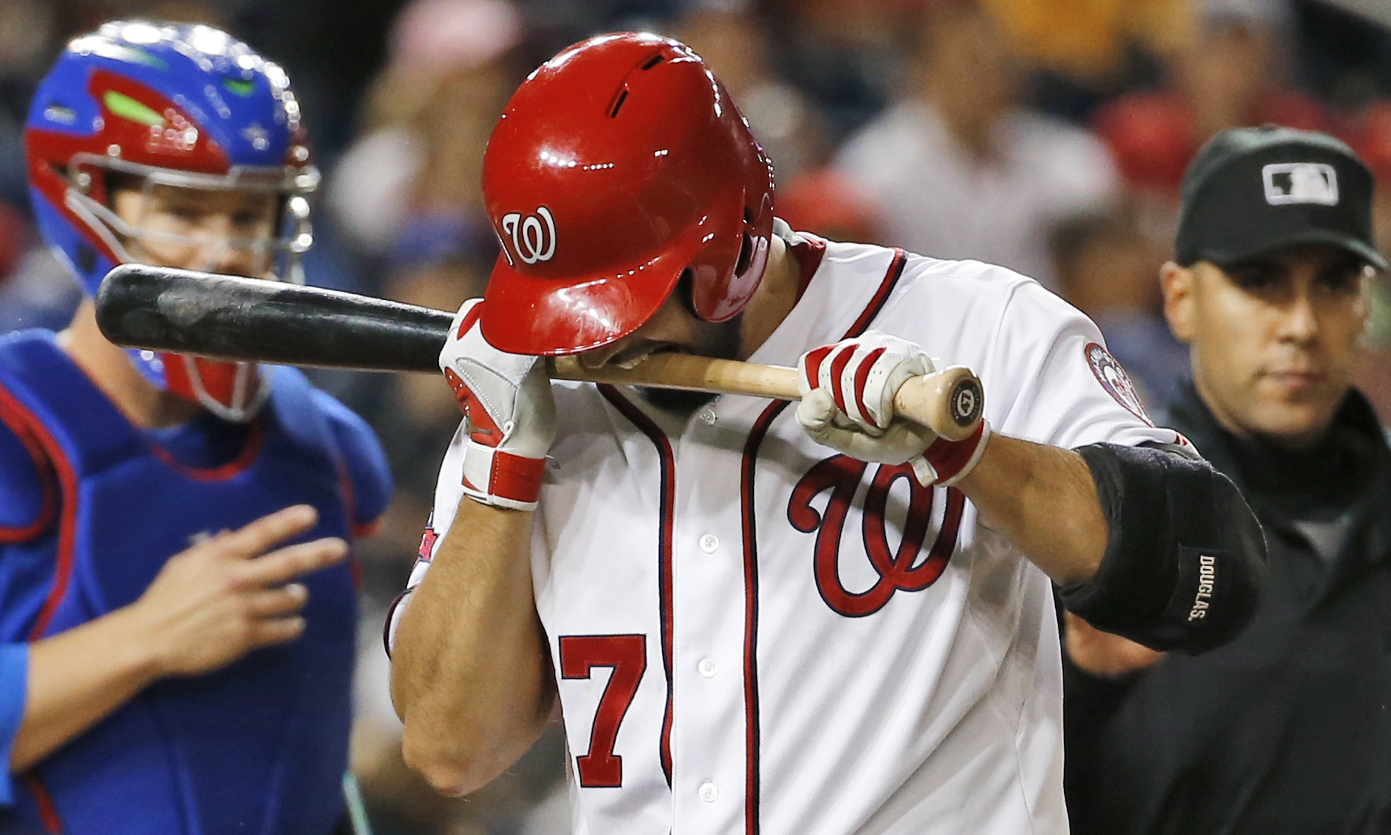 Washington Nationals starting pitcher Gio Gonzalez (47) bites his bat in frustration after striking out on a fouled bunt attempt during the third inning of a baseball game against the Chicago Cubs at Nationals Park, Thursday, June 4, 2015, in Washington.