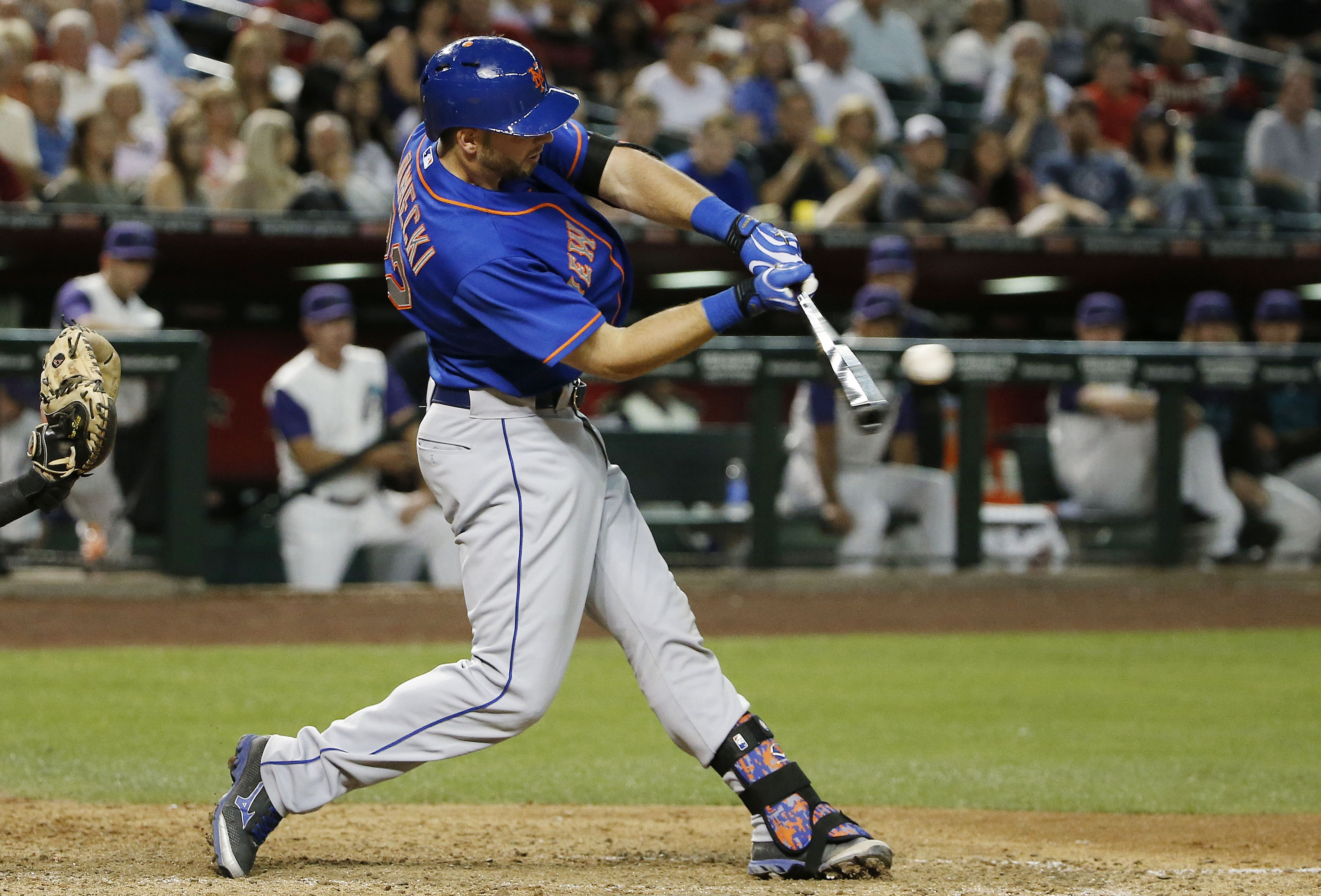 New York Mets' Kevin Plawecki connects for a two-run double against the Arizona Diamondbacks during the sixth inning of a baseball game Thursday, June 4, 2015, in Phoenix. (AP Photo/Ross D. Franklin)