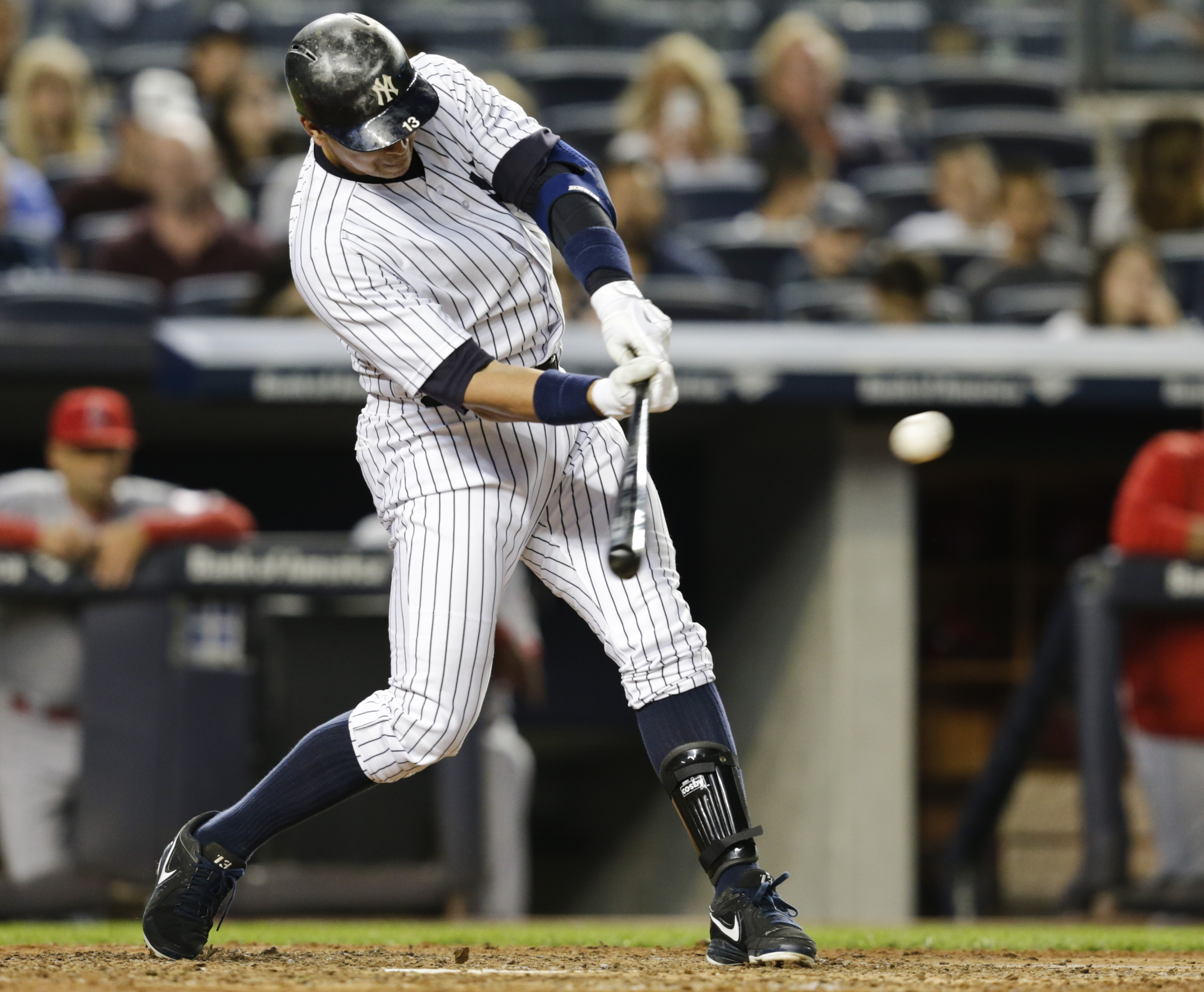 New York Yankees' Alex Rodriguez hits an hits an RBI single during the fifth inning of a baseball game against the Los Angeles Angels Friday, June 5, 2015, in New York. (AP Photo/Frank Franklin II)