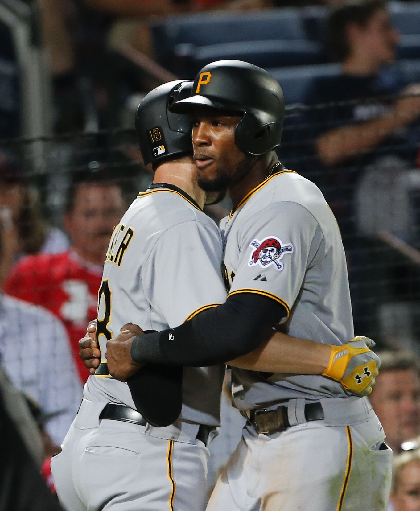 Pittsburgh Pirates second baseman Neil Walker (18), left, is embraces by Starling Marte (6) after hitting a three-run home run in the fifth inning of baseball game against the Atlanta Braves Friday, June 5, 2015, in Atlanta. (AP Photo/John Bazemore)