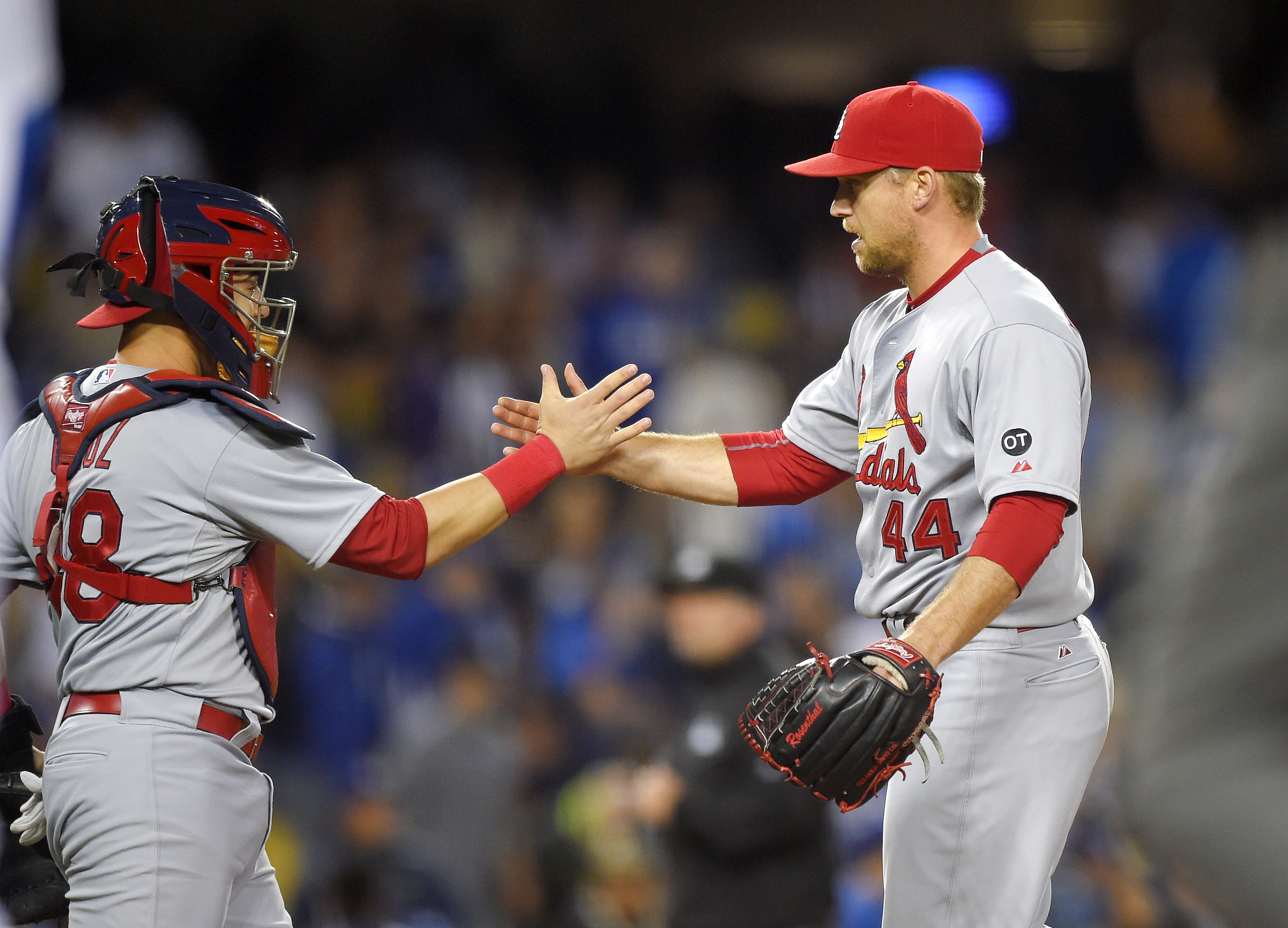 St. Louis Cardinals catcher Tony Cruz, left, and relief pitcher Trevor Rosenthal congratulated each other after the Cardinals defeated the Los Angeles Dodgers 2-1 in a baseball game, Friday, June 5, 2015, in Los Angeles. (AP Photo/Mark J. Terrill)