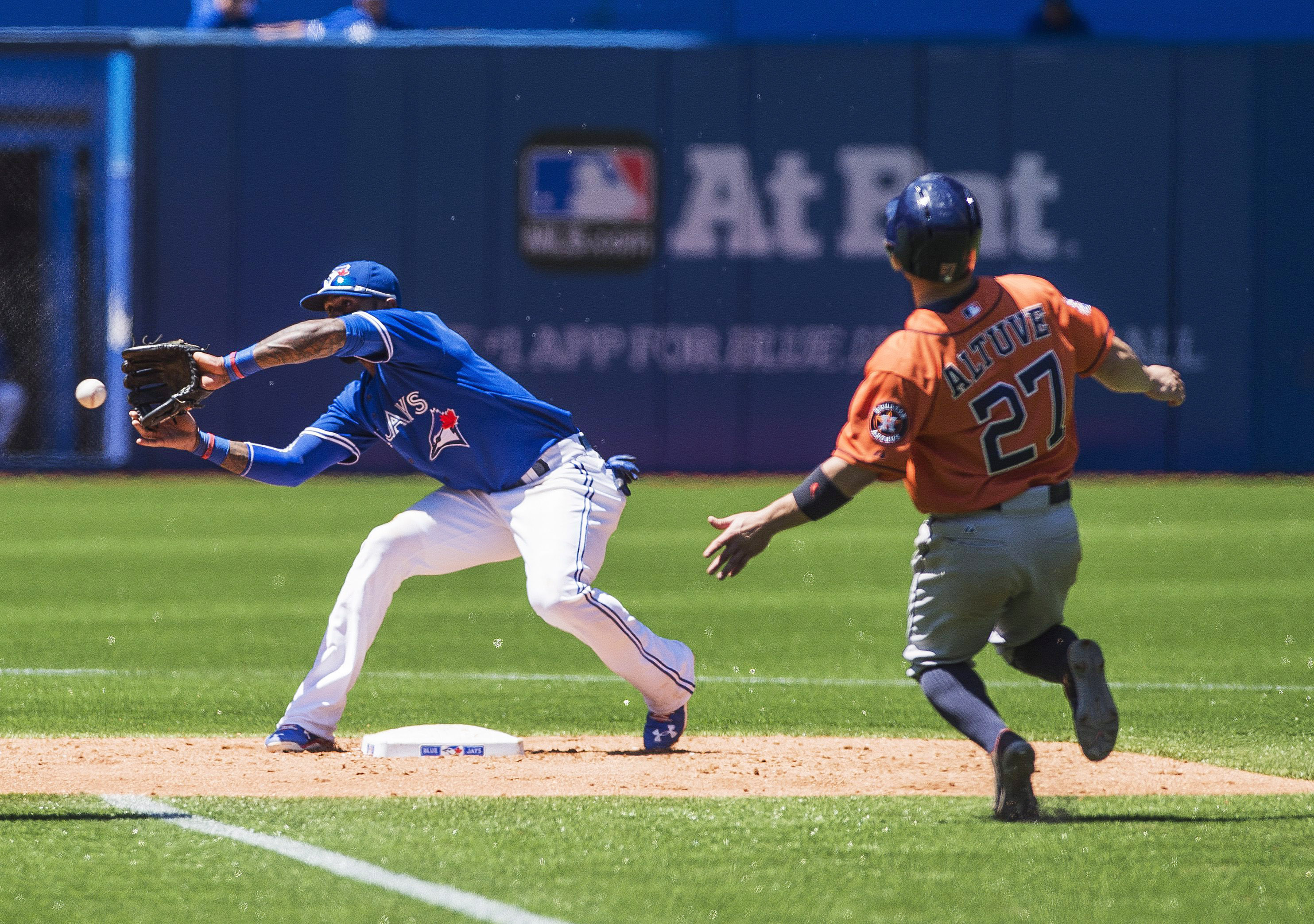 Toronto Blue Jays shortstop Jose Reyes prepares to tag Houston Astros' Jose Altuve as he's picked off stealing second base during the third inning of a baseball game, Saturday, June 6, 2015 in Toronto. (Aaron Vincent Elkaim/The Canadian Press via AP) MAND