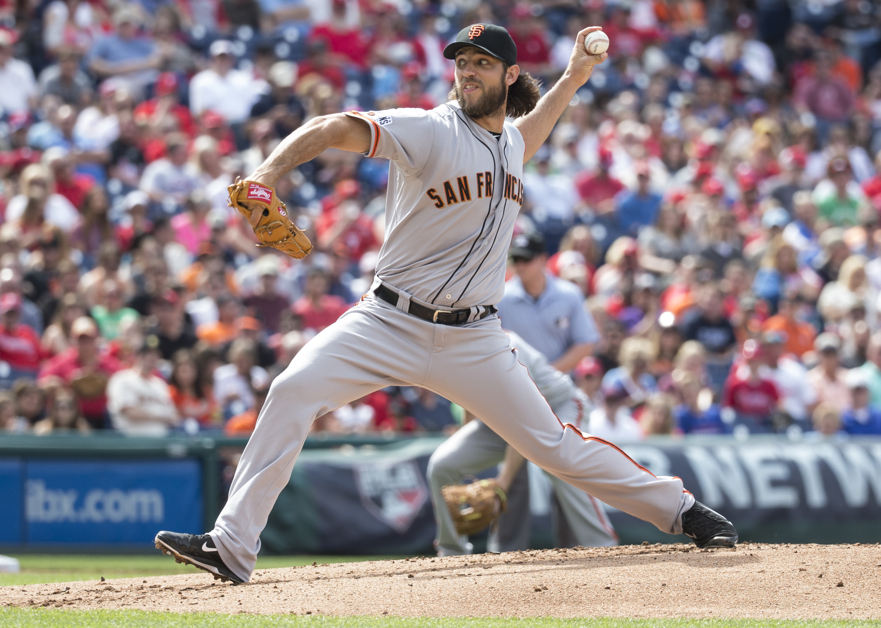 San Francisco Giants starting pitcher Madison Bumgarner throws a pitch during the first inning of a baseball game against the Philadelphia Phillies, Saturday, June 6, 2015, in Philadelphia. (AP Photo/Chris Szagola)