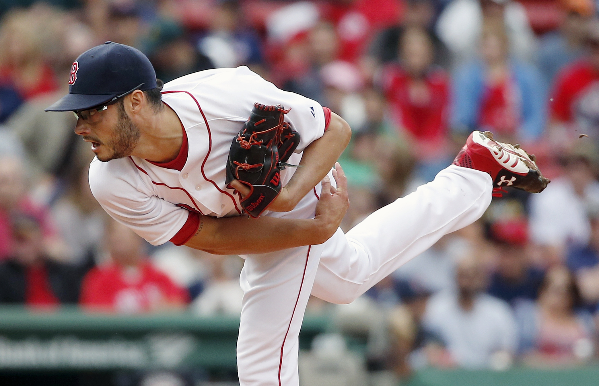 Boston Red Sox's Joe Kelly pitches during the first inning of a baseball game against the Oakland Athletics in Boston, Saturday, June 6, 2015. (AP Photo/Michael Dwyer)