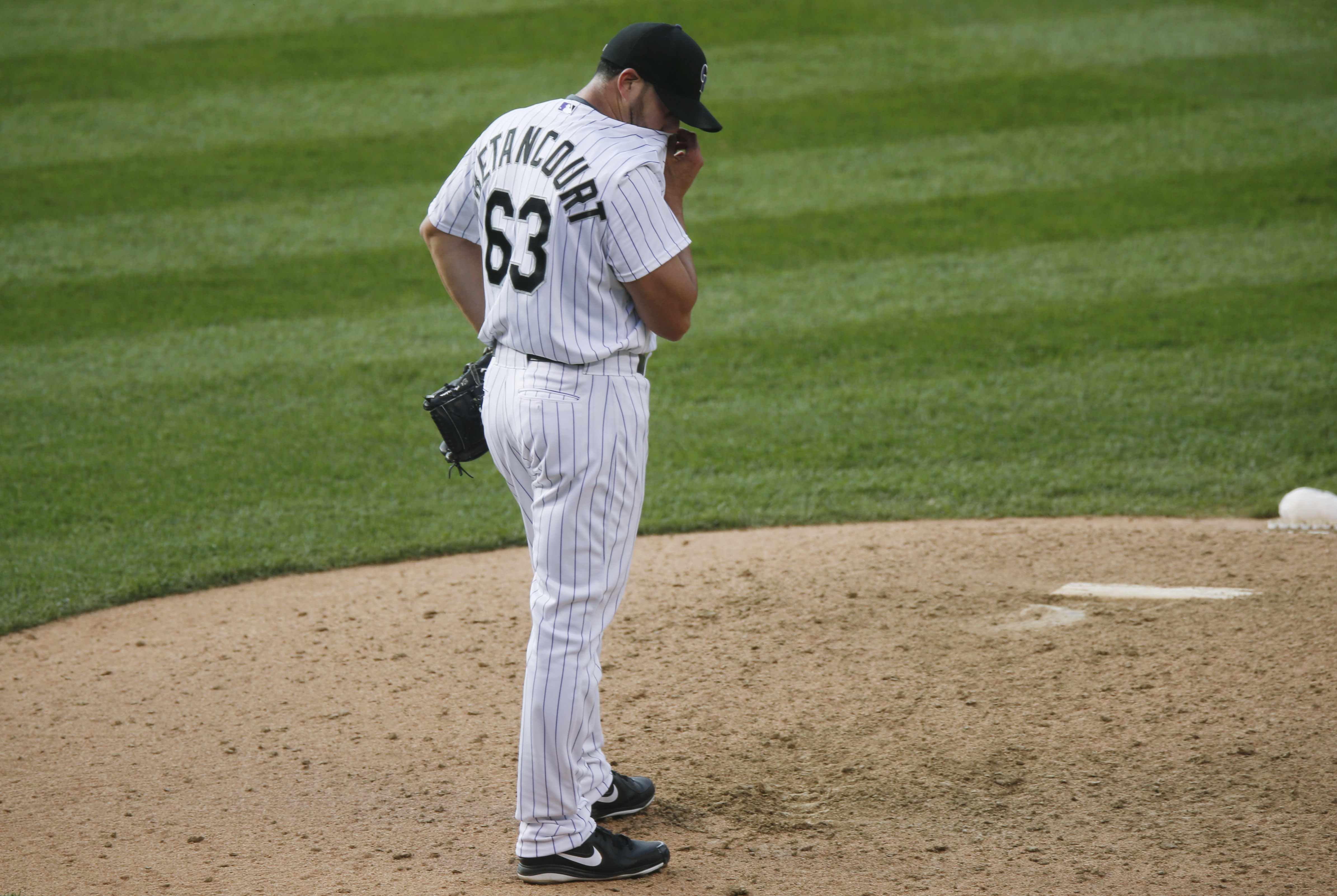 Colorado Rockies relief pitcher Rafael Betancourt reacts after giving up a single to allow in two runs to Miami Marlins' Jeff Baker in the bottom of the ninth inning of a baseball game Saturday, June 6, 2015, in Denver. Colorado won 10-5. (AP Photo/David