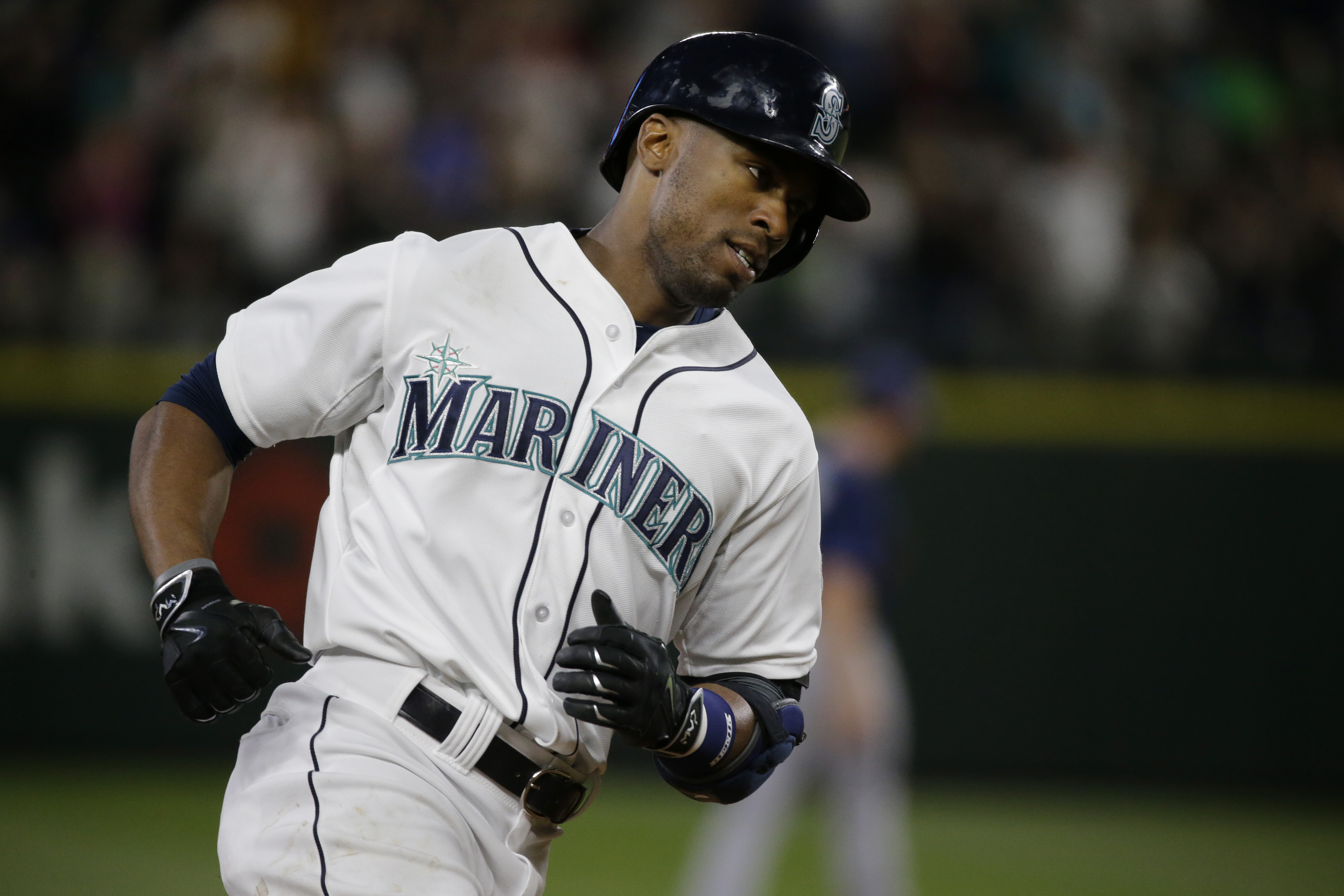 Seattle Mariners' Austin Jackson rounds the bases after he hit a solo home run in the seventh inning of a baseball game, Saturday, June 6, 2015, in Seattle. (AP Photo/Ted S. Warren)
