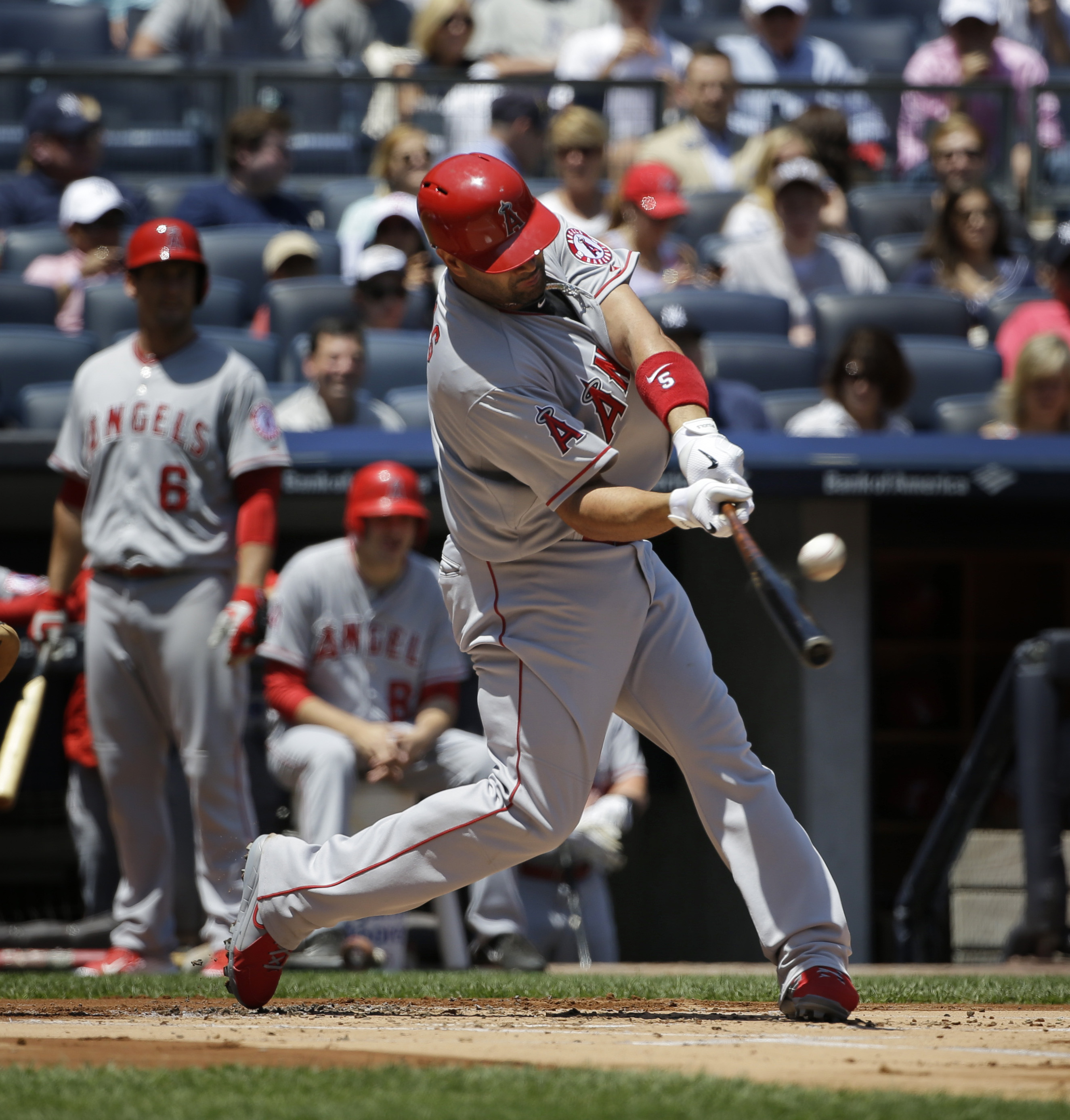 Los Angeles Angels' Albert Pujols hits a solo home run during the first inning of the baseball game against the New York Yankees, Sunday, June 7, 2015, in New York. (AP Photo/Seth Wenig)