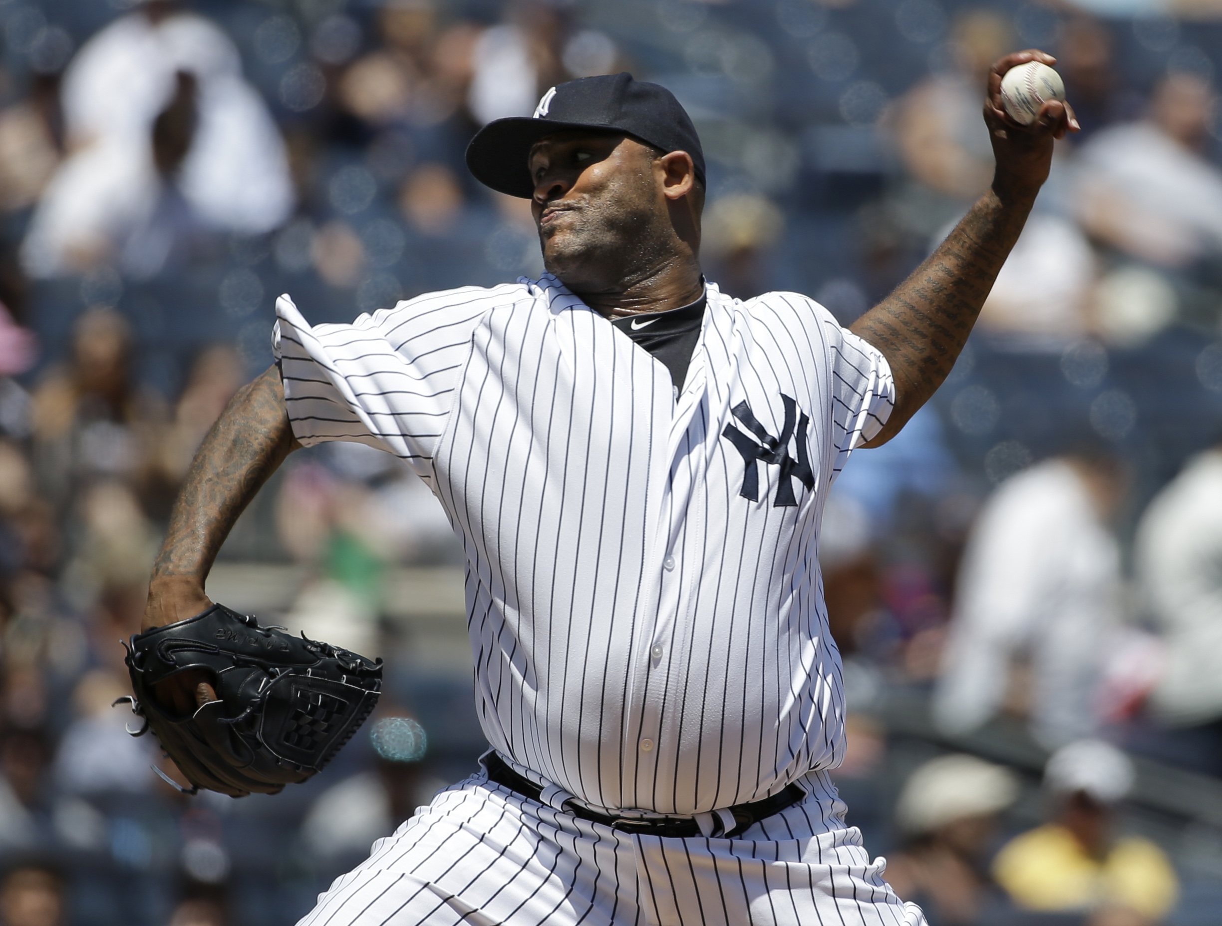 New York Yankees starting pitcher CC Sabathia throws during the first inning of a baseball game against the Los Angeles Angels, Sunday, June 7, 2015, in New York. (AP Photo/Seth Wenig)