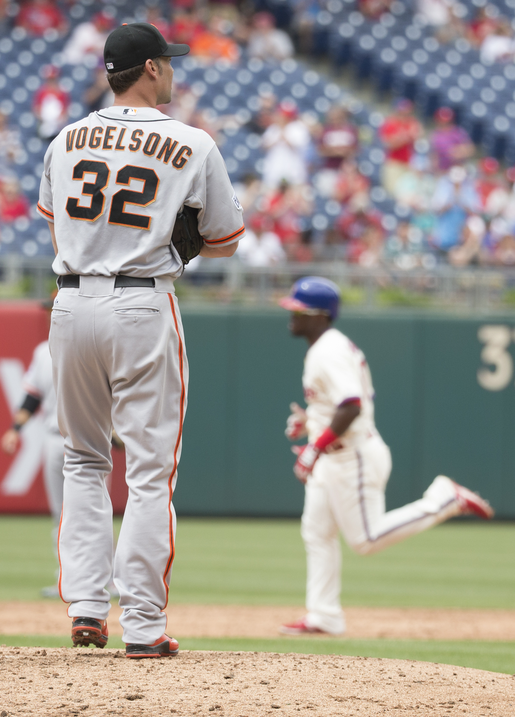 San Francisco Giants starting pitcher Ryan Vogelsong, left, looks away as Philadelphia Phillies' Odubel Herrera, right, rounds the bases after hitting a solo home run during the third inning of a baseball game, Sunday, June 7, 2015, in Philadelphia. (AP P