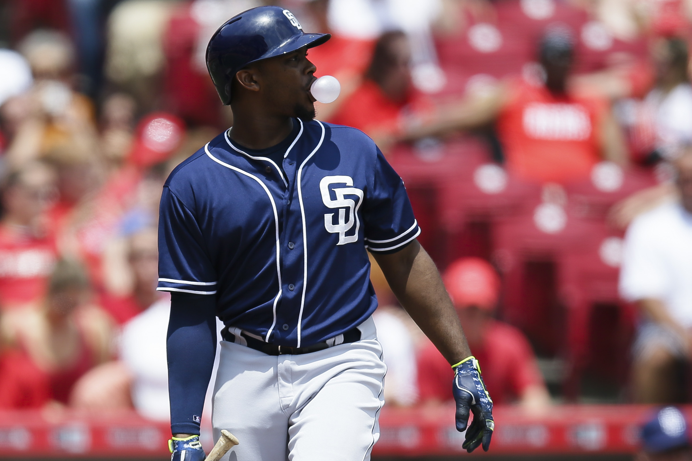 San Diego Padres' Justin Upton blows a gum bubble while at bat in the third inning of a baseball game against the Cincinnati Reds, Sunday, June 7, 2015, in Cincinnati. (AP Photo/John Minchillo)