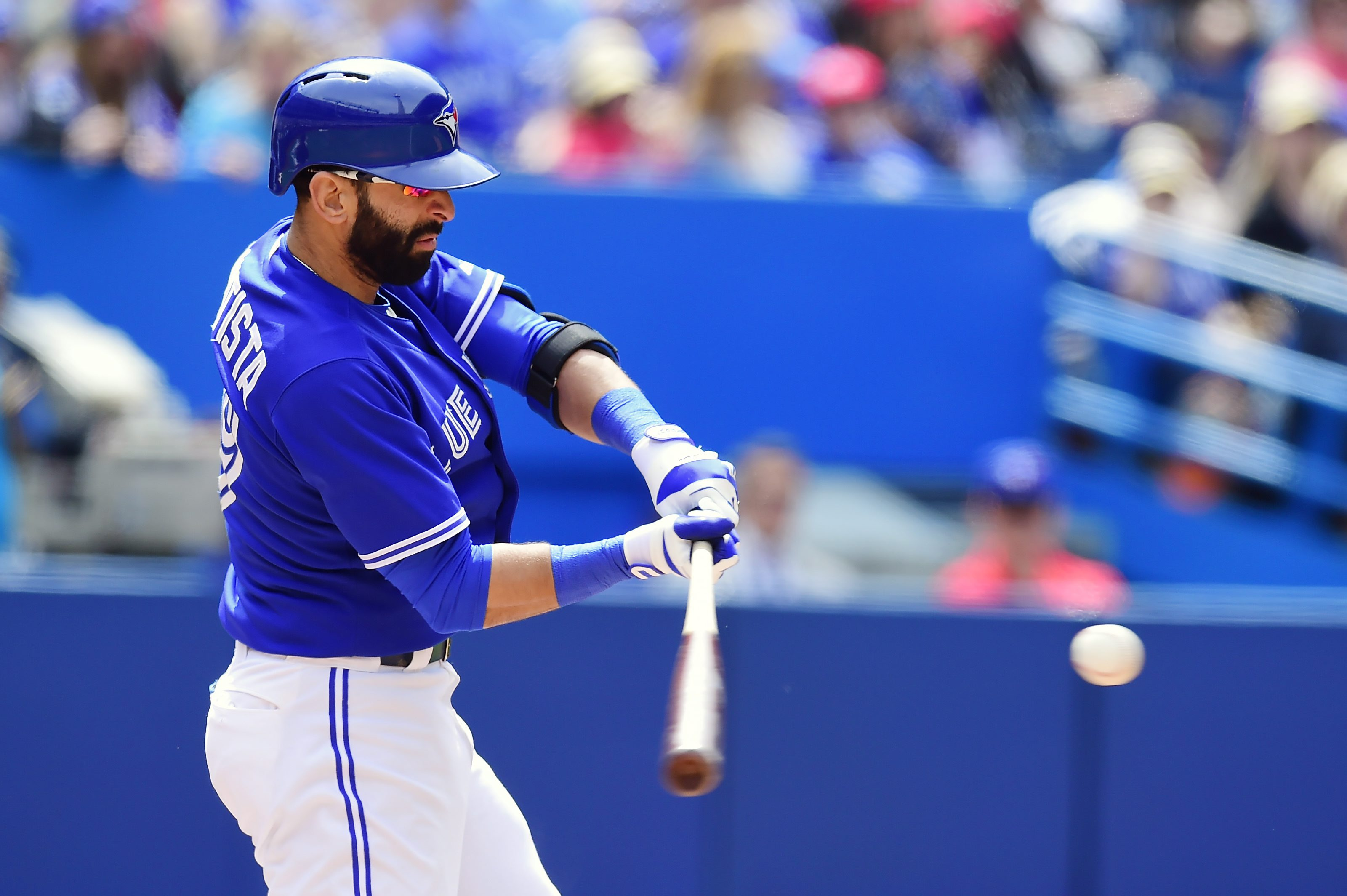 Toronto Blue Jays' Jose Bautista hits a home run during seventh-inning baseball game action against the Houston Astros on Sunday, June 7, 2015. (Frank Gunn/The Canadian Press via AP) MANDATORY CREDIT