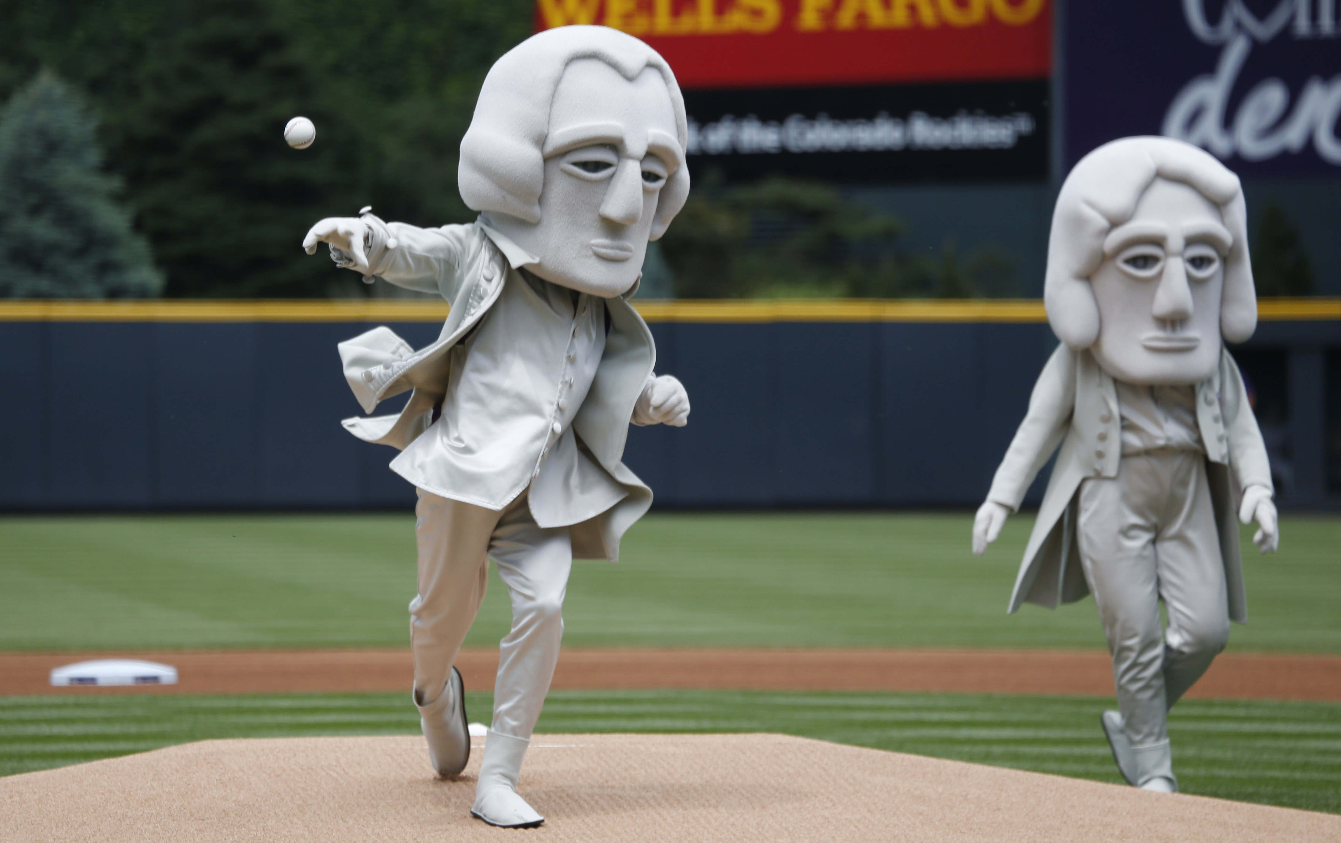 As part of an effort to promote tourism in the Black Hills of South Dakota, one of the U.S. Presidents depicted in the sculpture in the granite face of Mount Rushmore, George Washington, throws out the ceremonial first pitch under the watch of Thomas Jeff