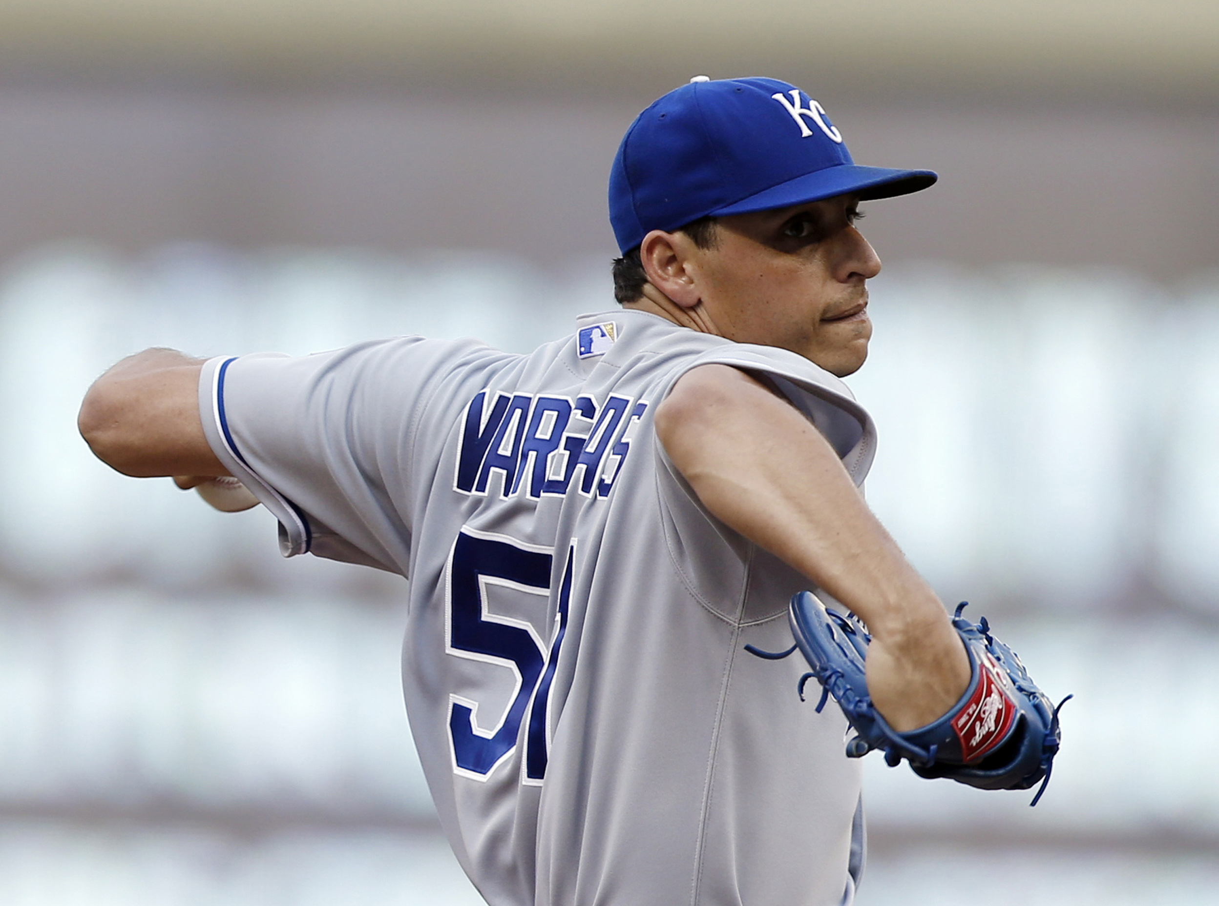 Kansas City Royals pitcher Jason Vargas throws against the Minnesota Twins in the first inning of a baseball game Monday, June 8, 2015, in Minneapolis. (AP Photo/Jim Mone)