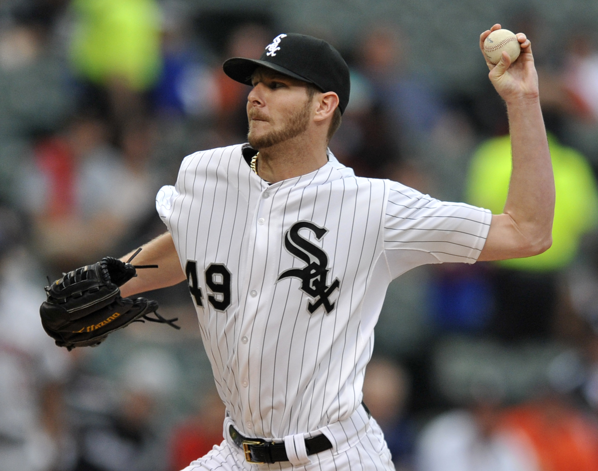 Chicago White Sox starter Chris Sale delivers a pitch during the first inning of a baseball game against the Houston Astros, Monday, June 8, 2015 in Chicago. (AP Photo/Paul Beaty)