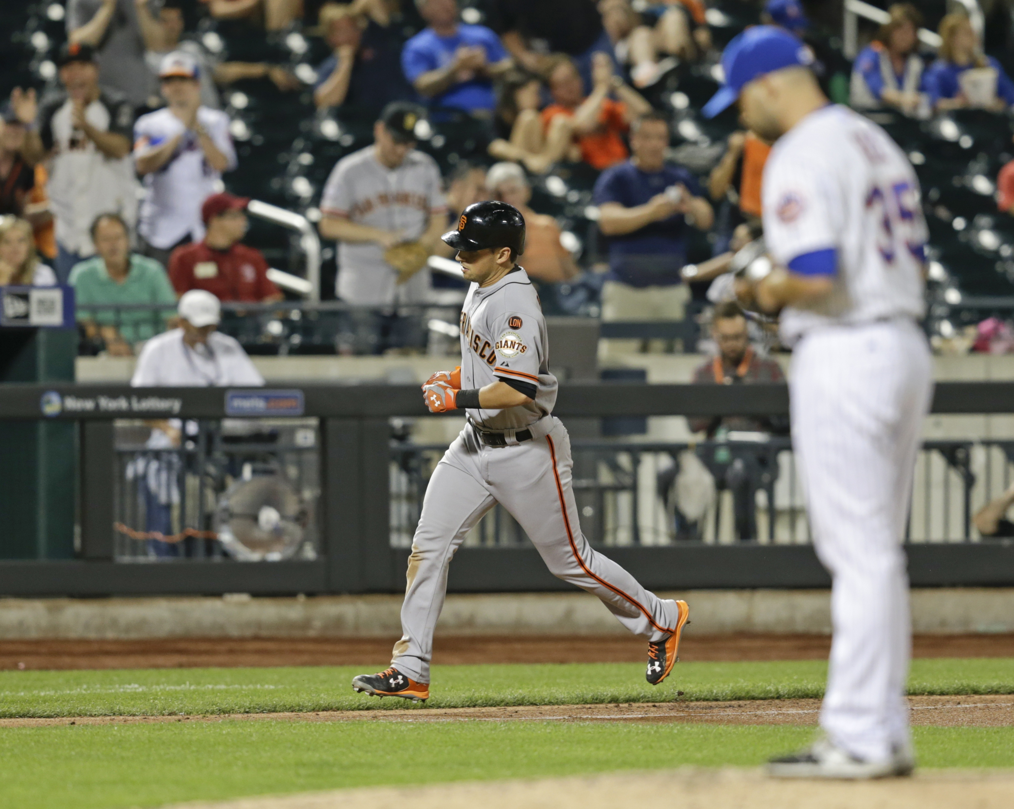 San Francisco Giants' Joe Panik heads home after hitting a home run off New York Mets pitcher Dillon Gee (35) during the seventh inning of a baseball game Tuesday, June 9, 2015, in New York. (AP Photo/Frank Franklin II)