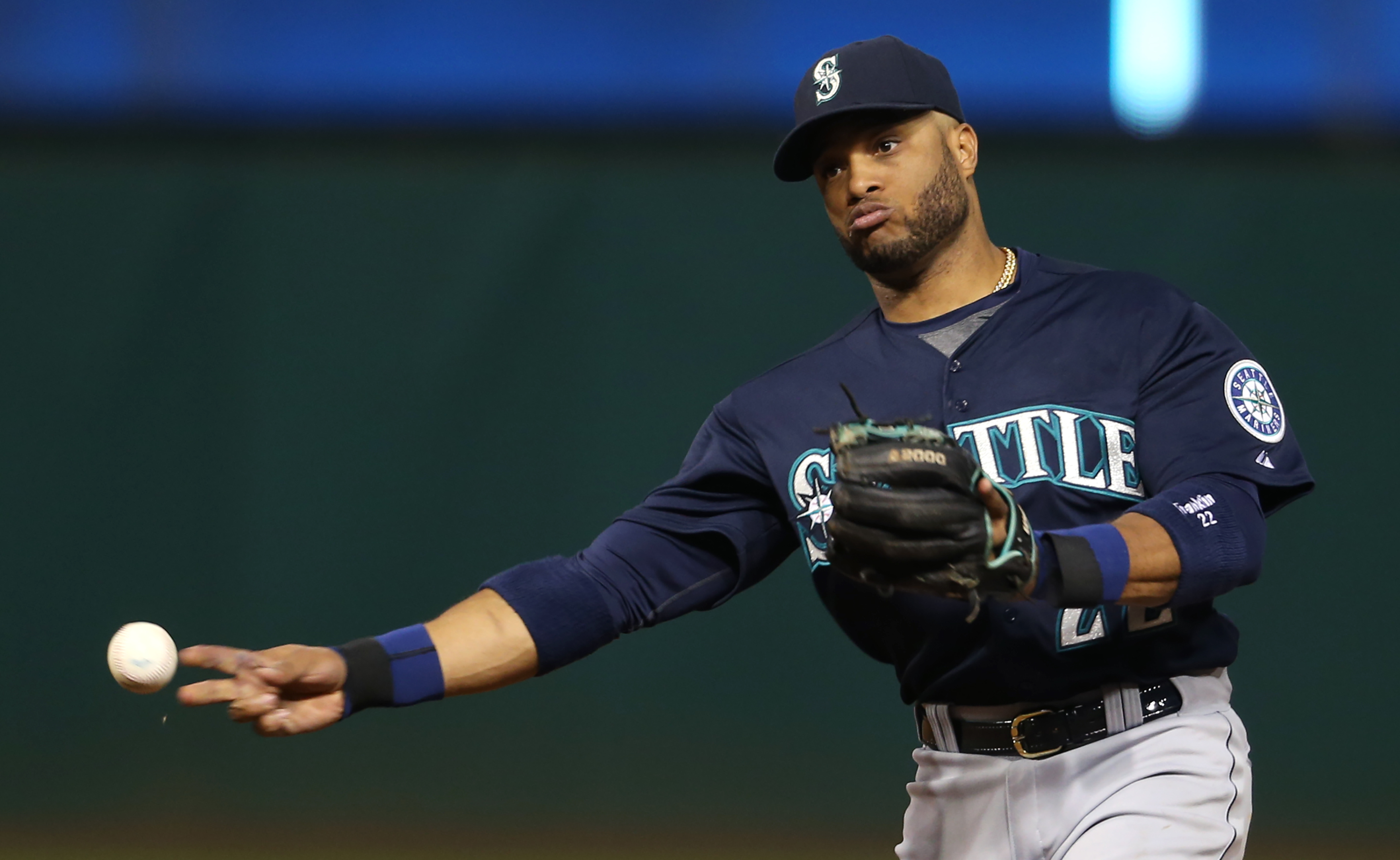 Seattle Mariners' Robinson Cano throws out Cleveland Indians' Mike Aviles at first base during the seventh inning of a baseball game, Tuesday, June 9, 2015, in Cleveland. (AP Photo/Ron Schwane)