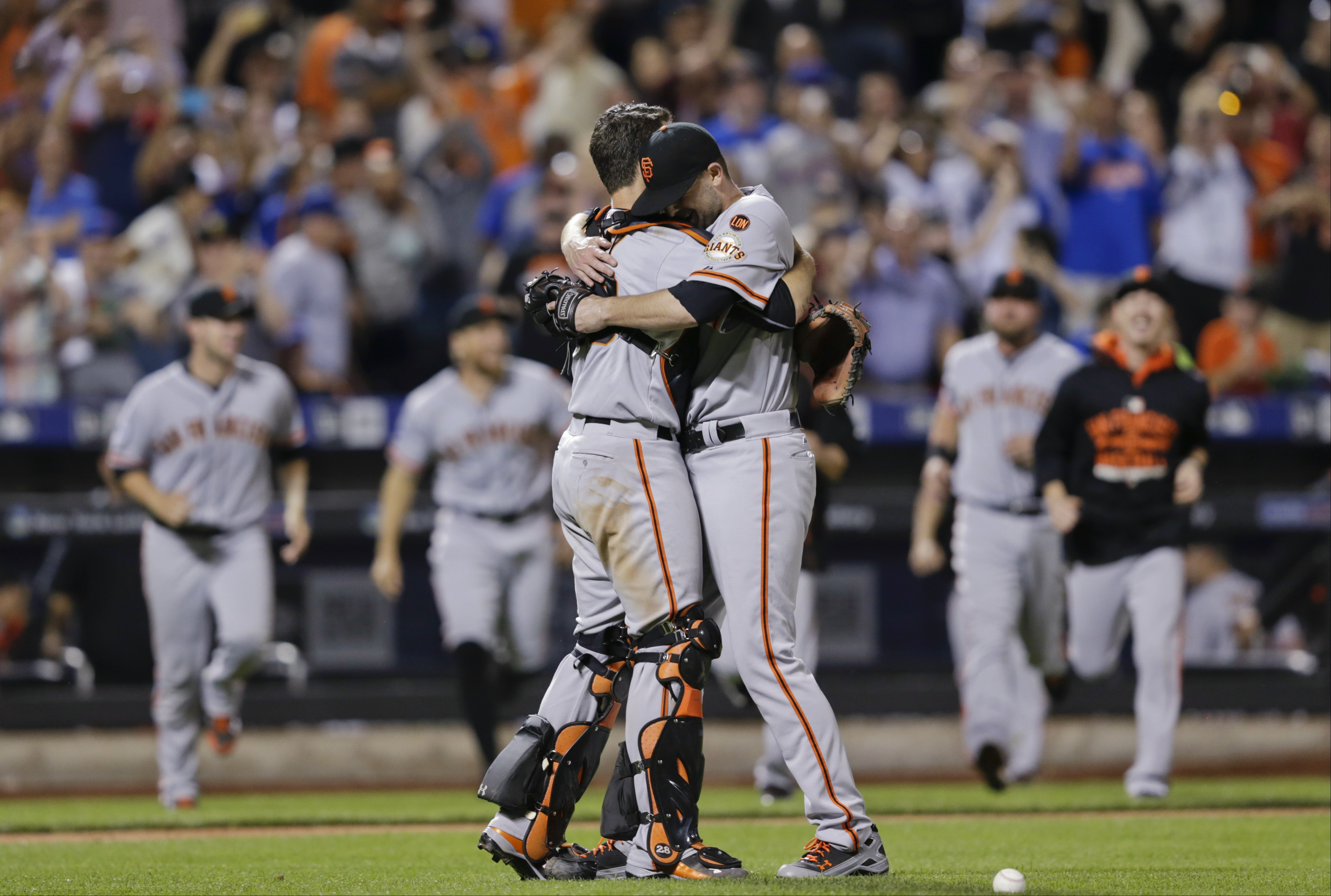 San Francisco Giants starting pitcher Chris Heston hugs catcher Buster Posey, left, after Heston's no-hitter in a baseball game against the New York Mets on Tuesday, June 9, 2015, in New York. The Giants won 5-0. (AP Photo/Frank Franklin II)