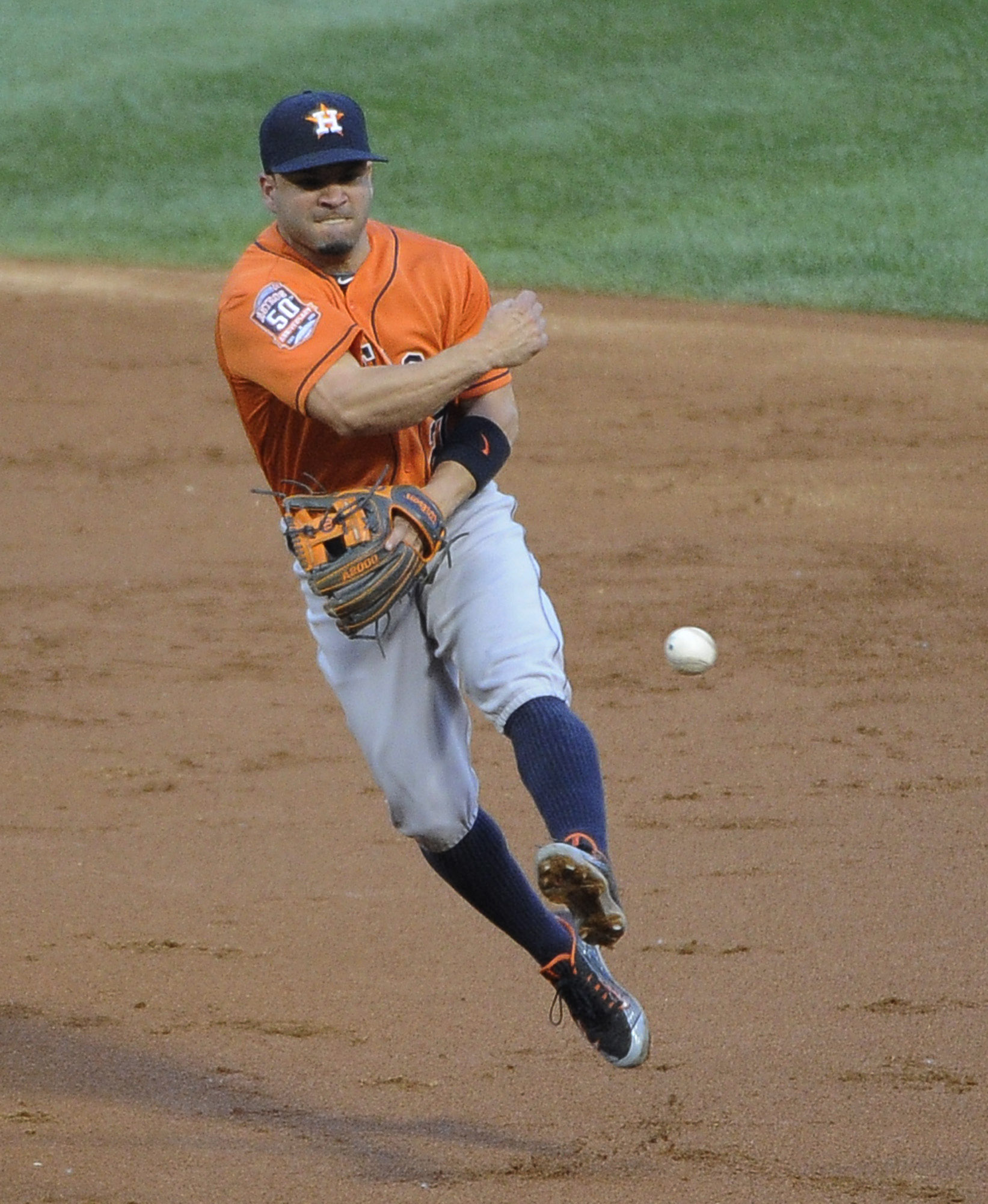 Houston Astros second baseman Jose Altuve (27) makes a play on Chicago White Sox's Adam Eaton during the third inning of a baseball game,Tuesday, June 9, 2015 in Chicago. (AP Photo/David Banks)