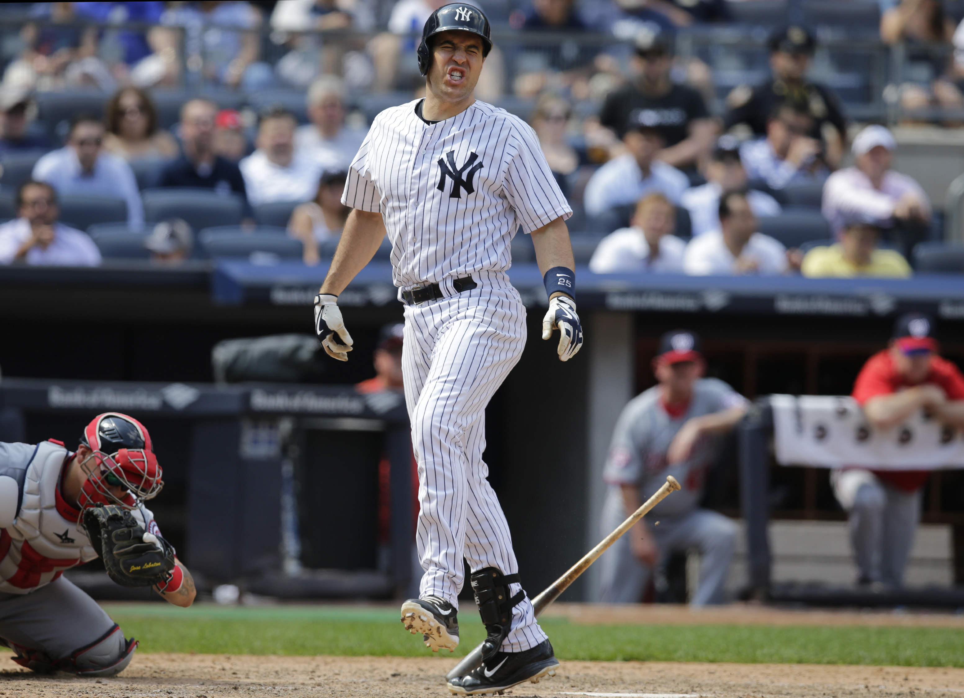 New York Yankees' Mark Teixeira reacts after fouling a ball off his foot during a baseball game against the Washington Nationals, Wednesday, June 10, 2015 in New York.  (AP Photo/Kathy Willens)