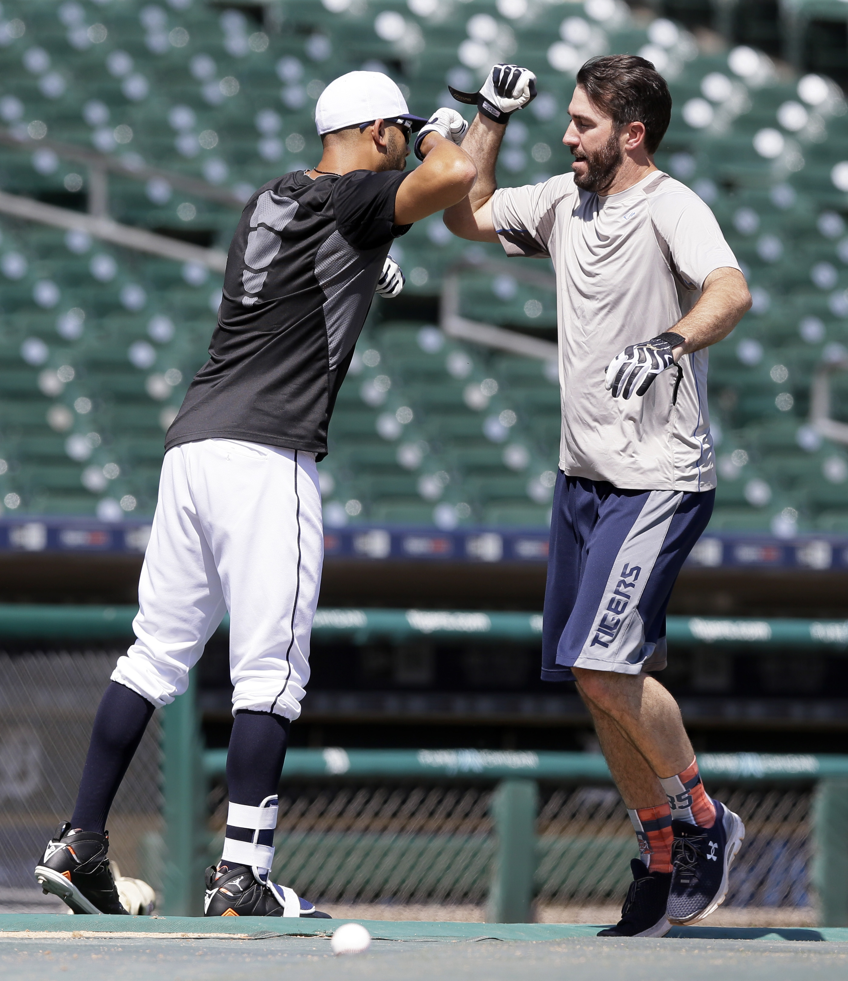 Detroit Tigers pitcher Justin Verlander, right, is greeted at home plate by pitcher David Price after hitting a home run during batting practice before a baseball game against the Chicago Cubs, Wednesday, June 10, 2015, in Detroit. (AP Photo/Carlos Osorio