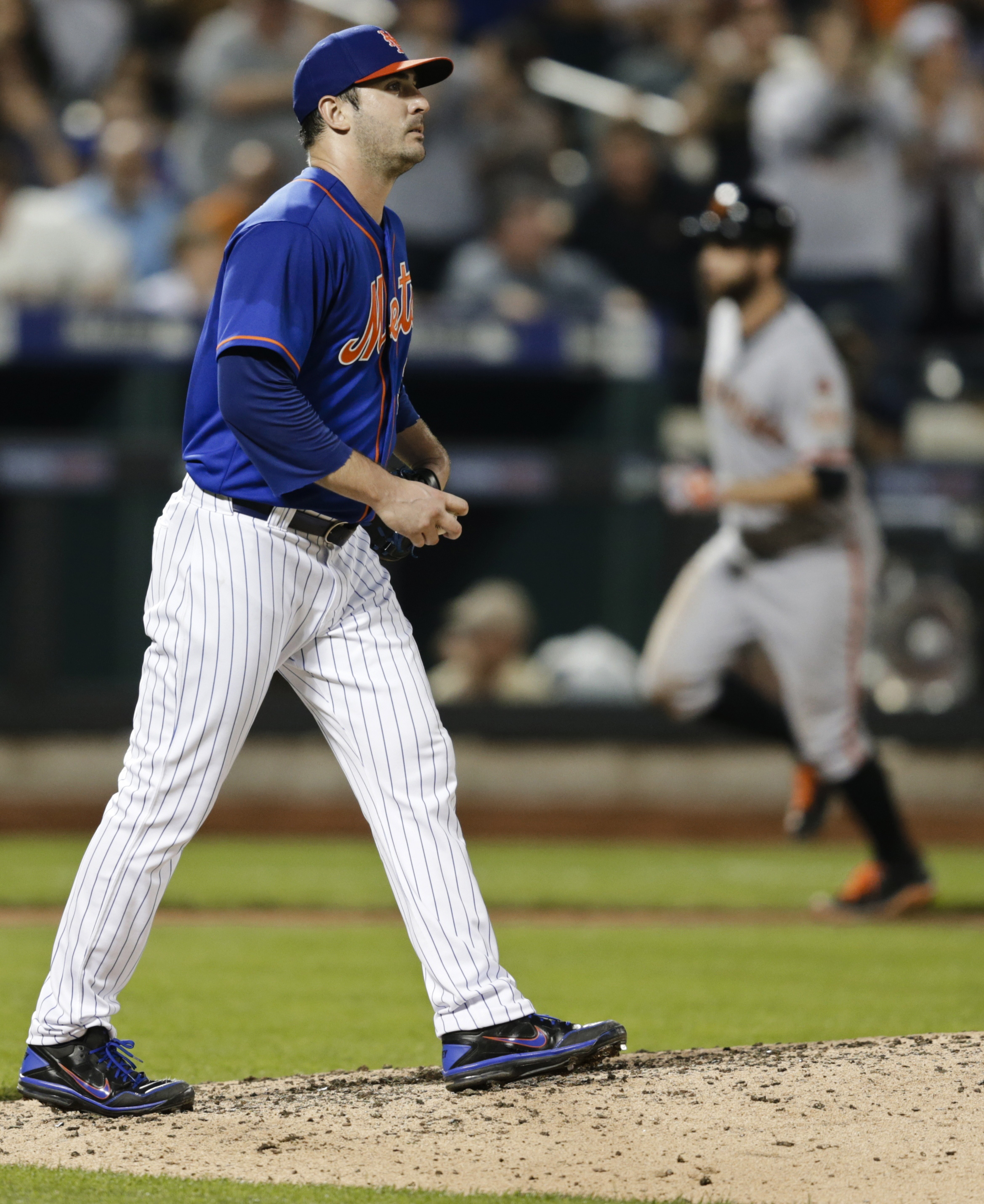 New York Mets starting pitcher Matt Harvey waits as San Francisco Giants' Brandon Belt runs the bases after hitting a two-run home run during the sixth inning of a baseball game Wednesday, June 10, 2015, in New York. (AP Photo/Frank Franklin II)