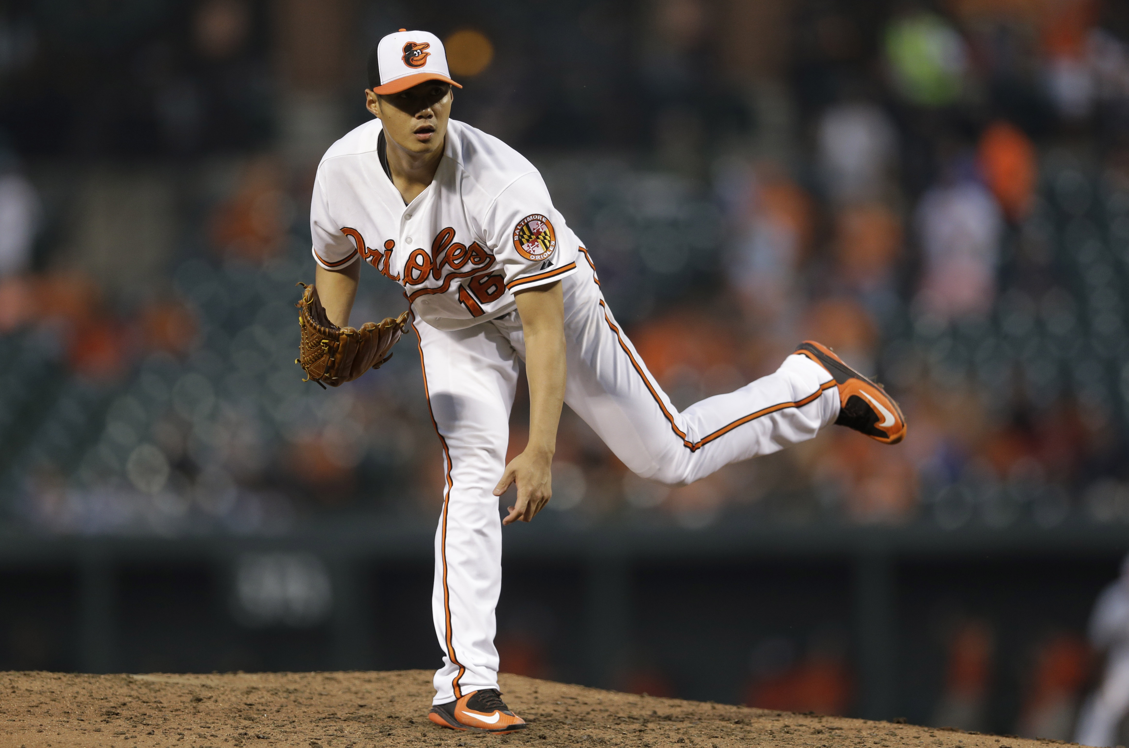 Baltimore Orioles starting pitcher Wei-Yin Chen, of Taiwan, follows through on a pitch to the Boston Red Sox during the fifth inning of a baseball game, Wednesday, June 10, 2015, in Baltimore. (AP Photo/Patrick Semansky)