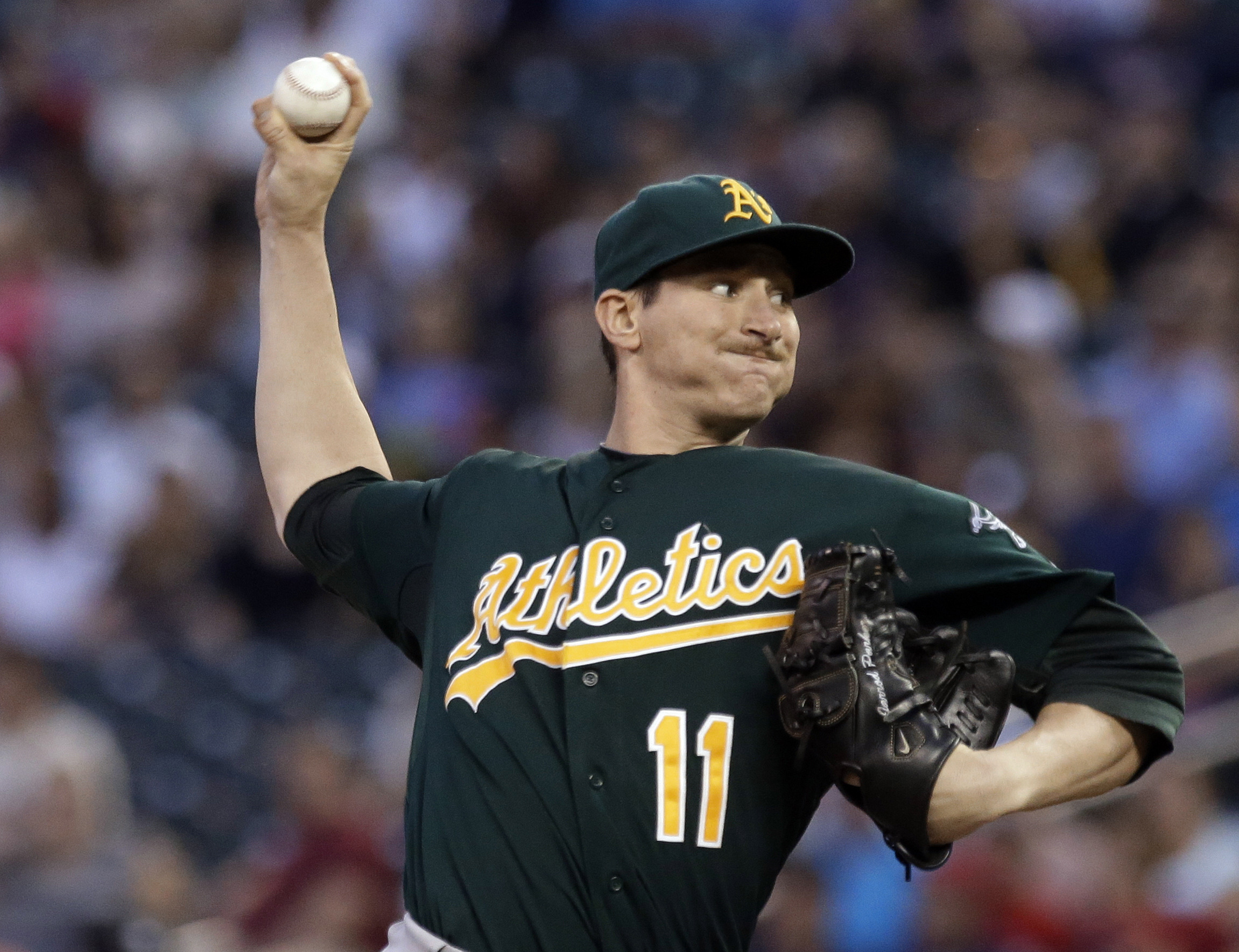 FILE - In this Sept. 10, 2013, file photo, Oakland Athletics pitcher Jarrod Parker throws against the Minnesota Twins during a baseball game in Minneapolis.  Parker is uncertain about the protocol for his recovery from a fractured elbow following two Tomm
