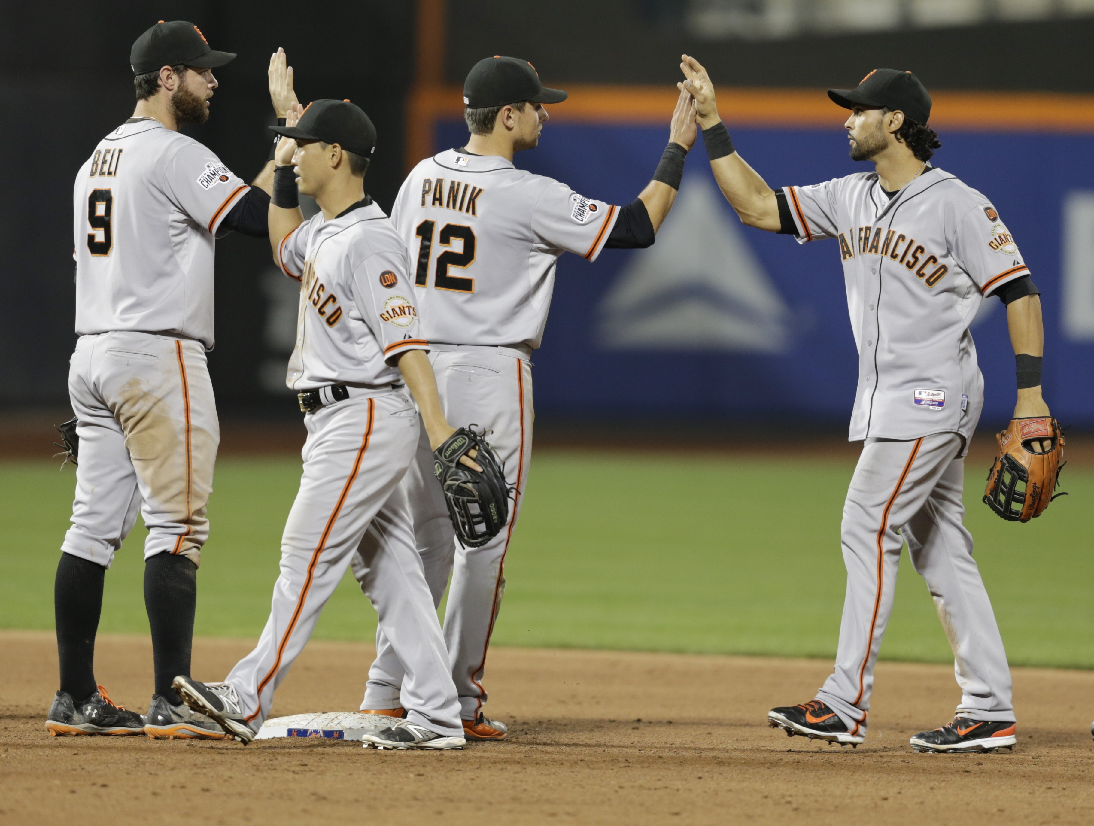 San Francisco Giants' Brandon Belt, Nori Aoki, Joe Panik and Angel Pagan, from left, celebrate after a baseball game against the New York Mets on Wednesday, June 10, 2015, in New York. The Giants won 8-5. (AP Photo/Frank Franklin II)